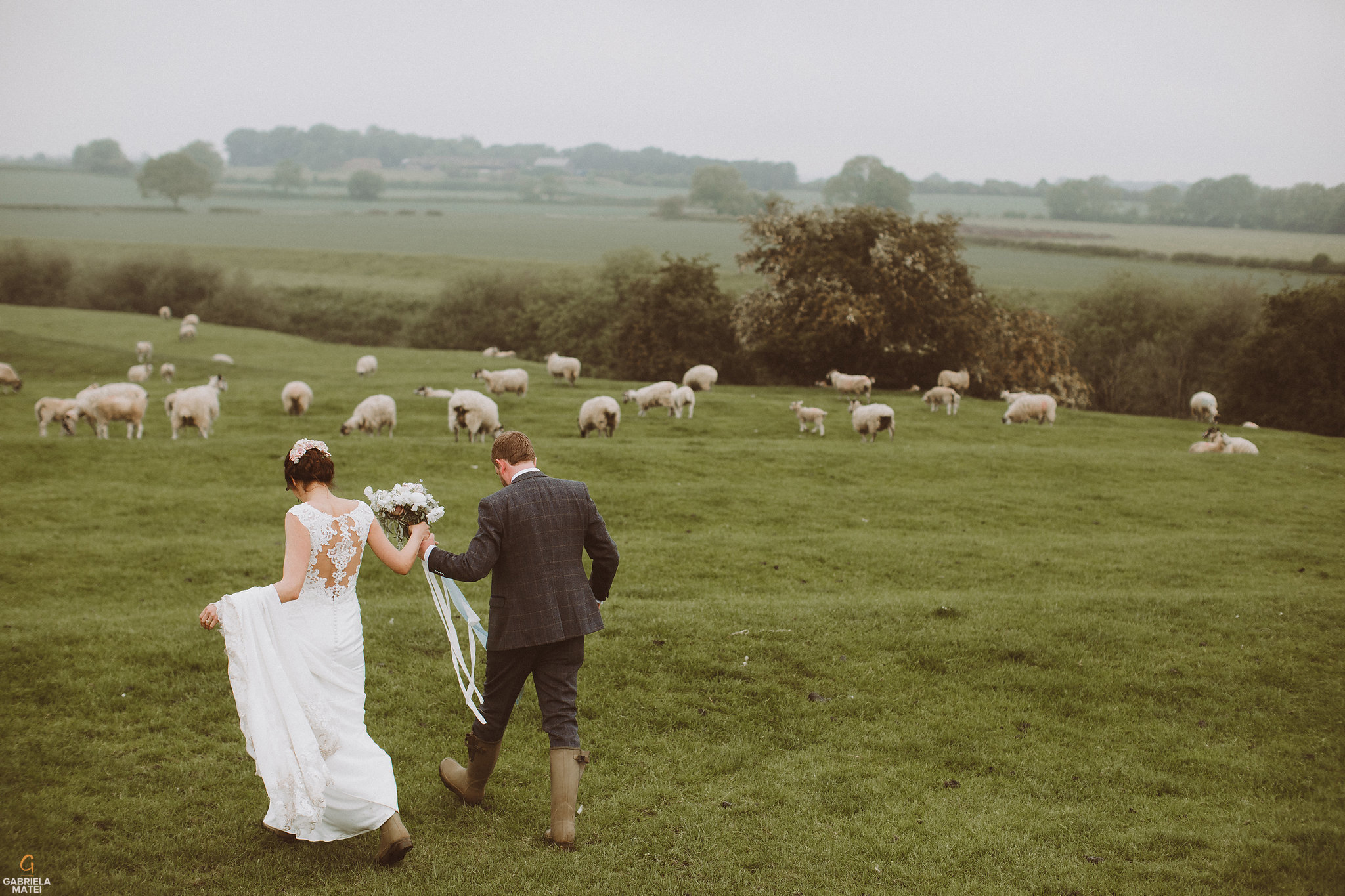 wedding photographer Sussex, countryside wedding, wedding dress and wellies, wellies and weddings