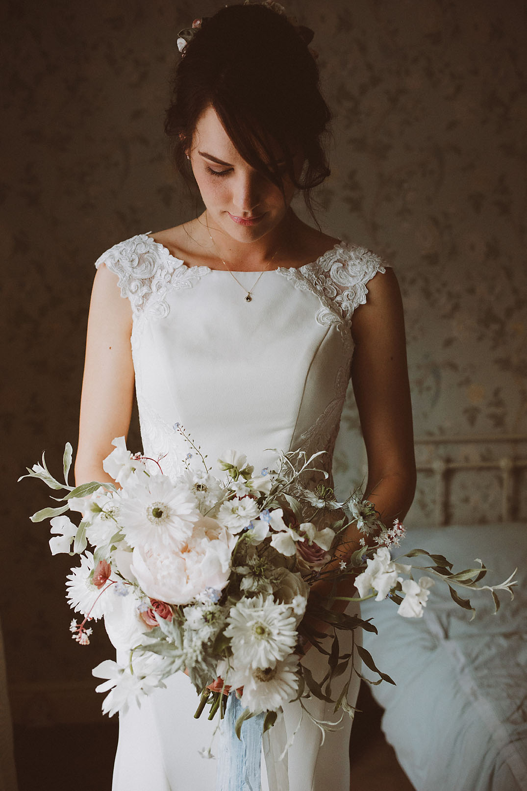 bridal portrait holding elegant bouquet, side lighting, natural light photography,
