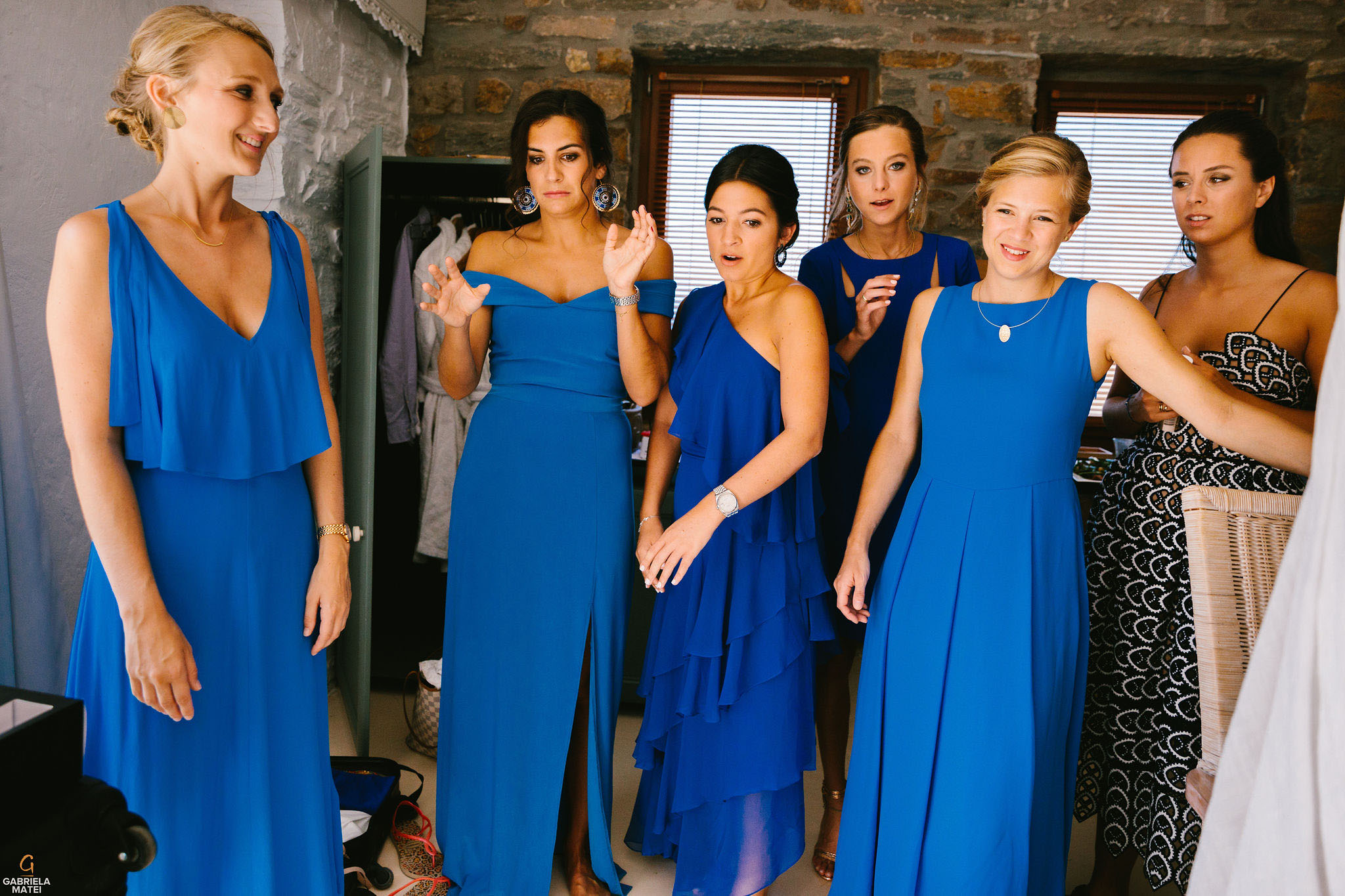 Bridesmaids with different facial expressions during bridal prep on Kea Island