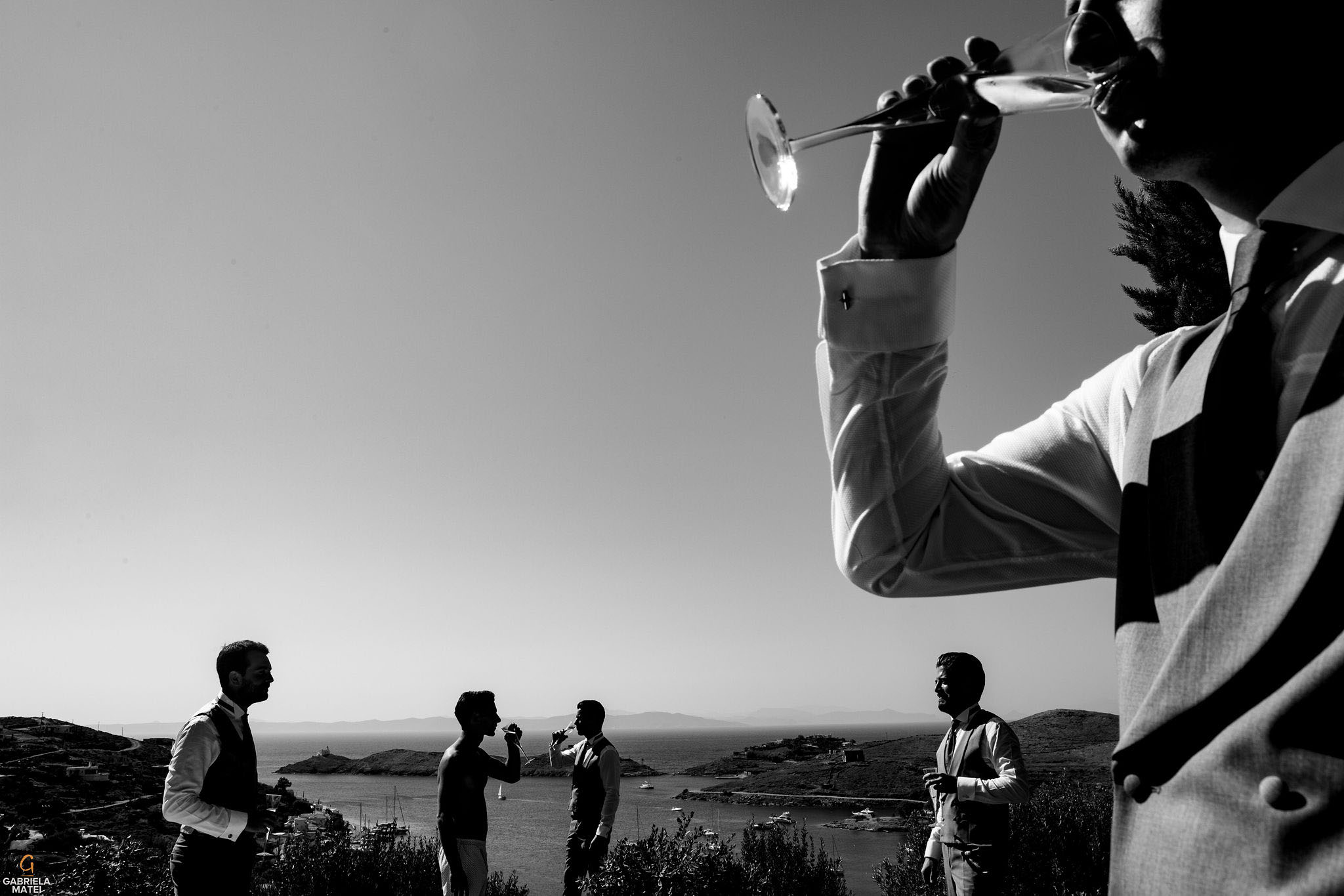 Groomsmen having champagne outdoor with stunning view towards Agean Sea on Kea Island