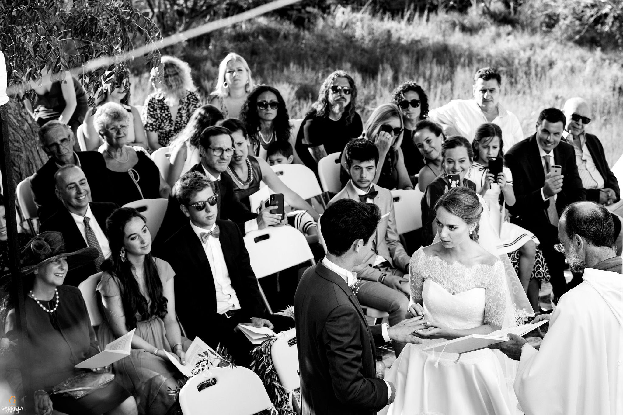 Wedding couple exchanging wedding rings during wedding ceremony on Kea Island