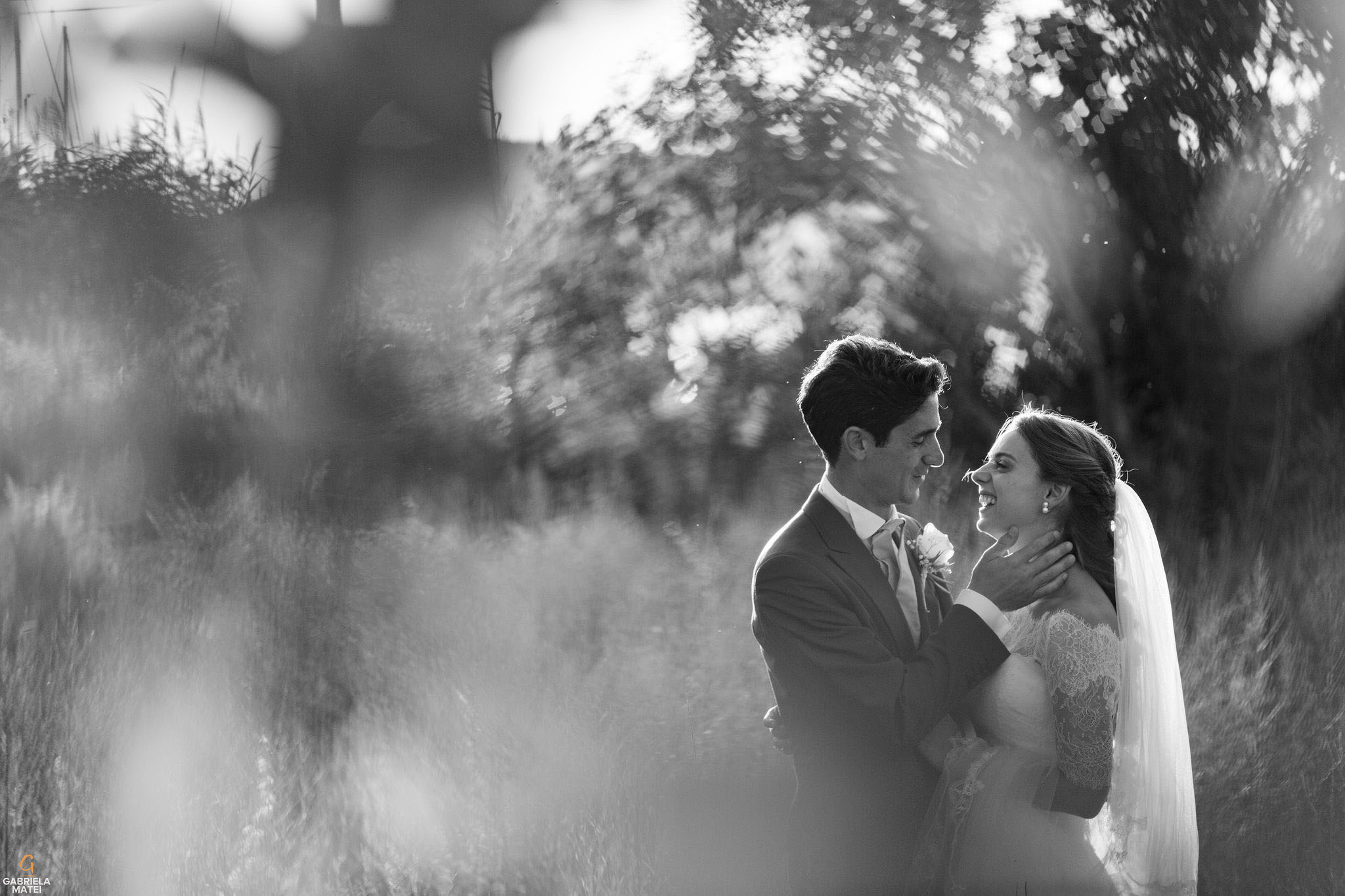 Bride and groom kissing in beautiful afternoon light on Kea Island, Greece