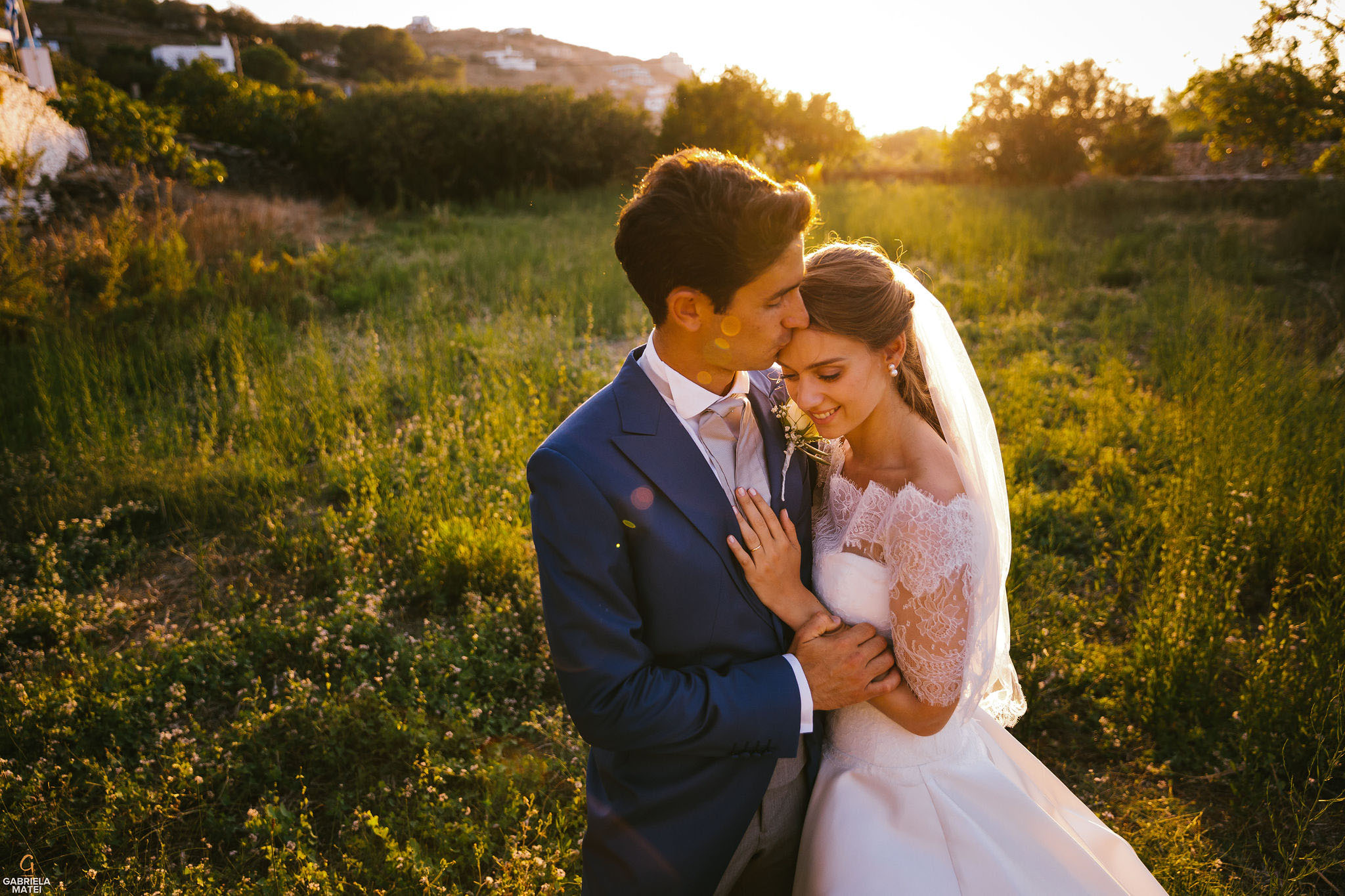Bride and groom cuddled up in sunset light on Kea Island