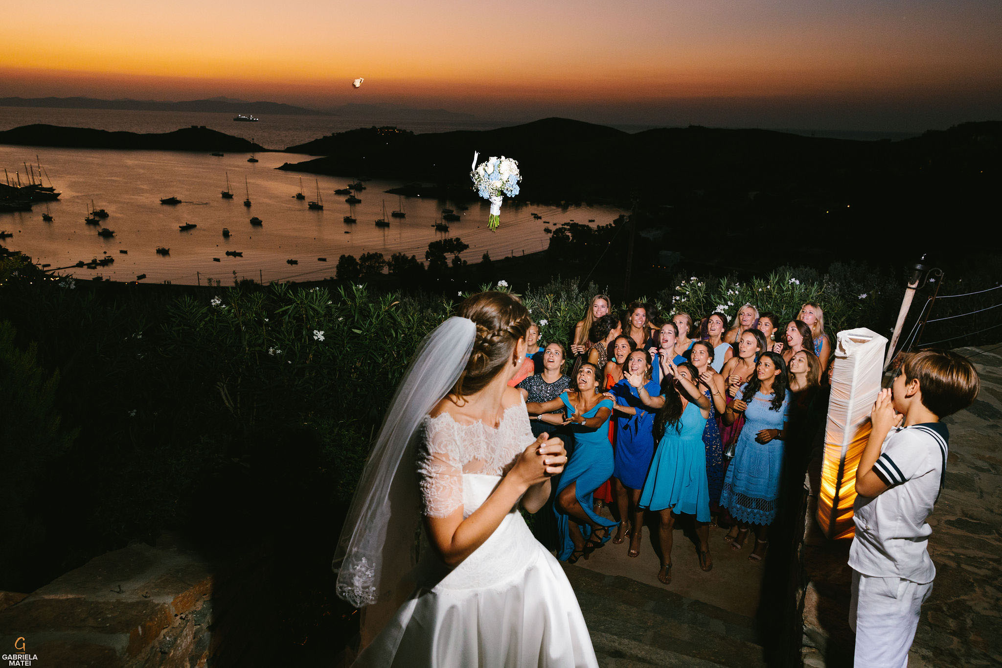 Bouquet throw at sunset with Aegean Sea in the background