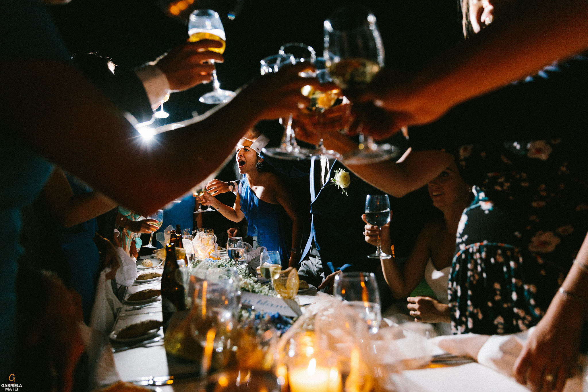 guests raising glasses together during wedding reception on Kea island