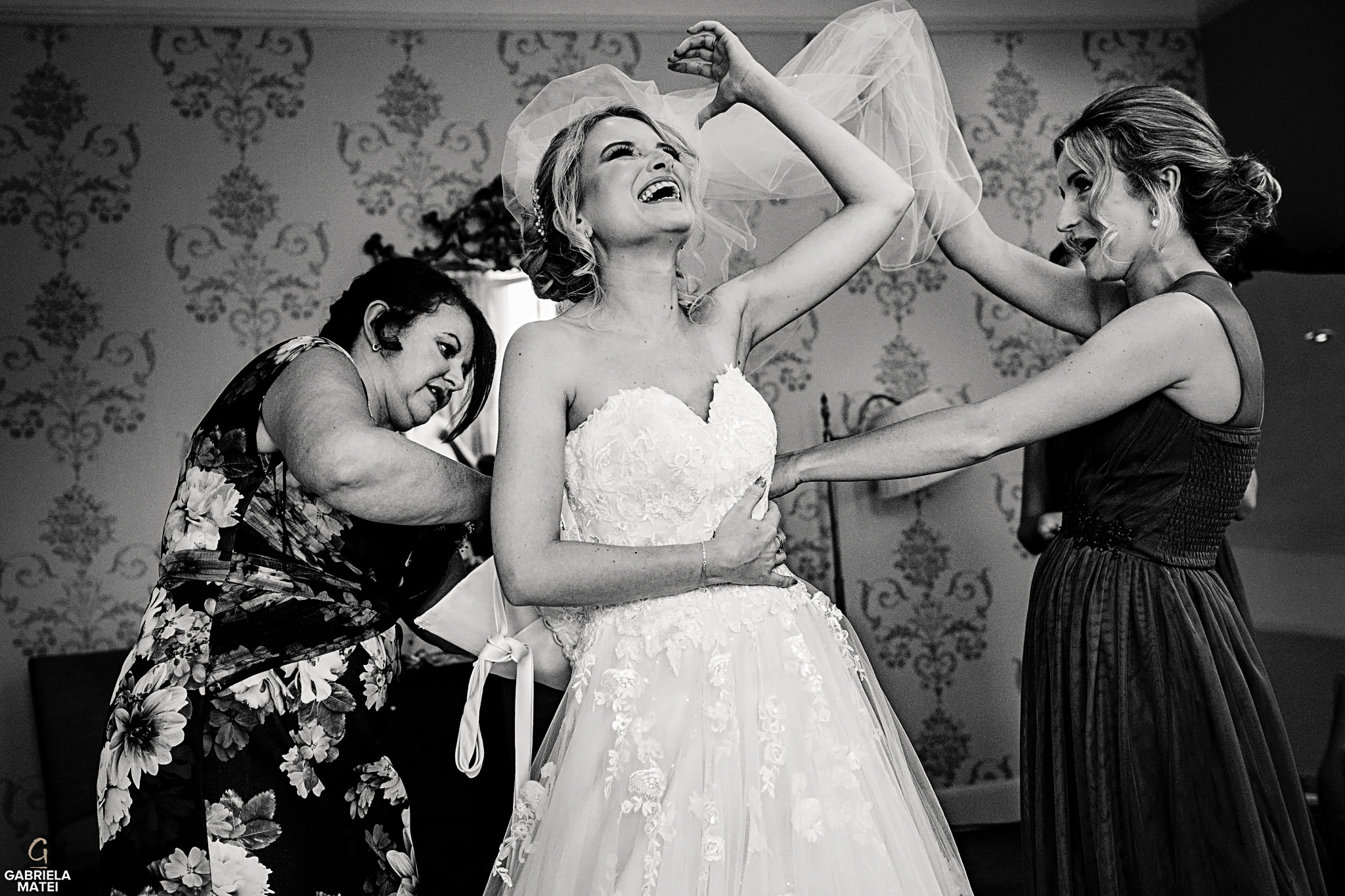 Bride laughing during her getting ready in London hotel