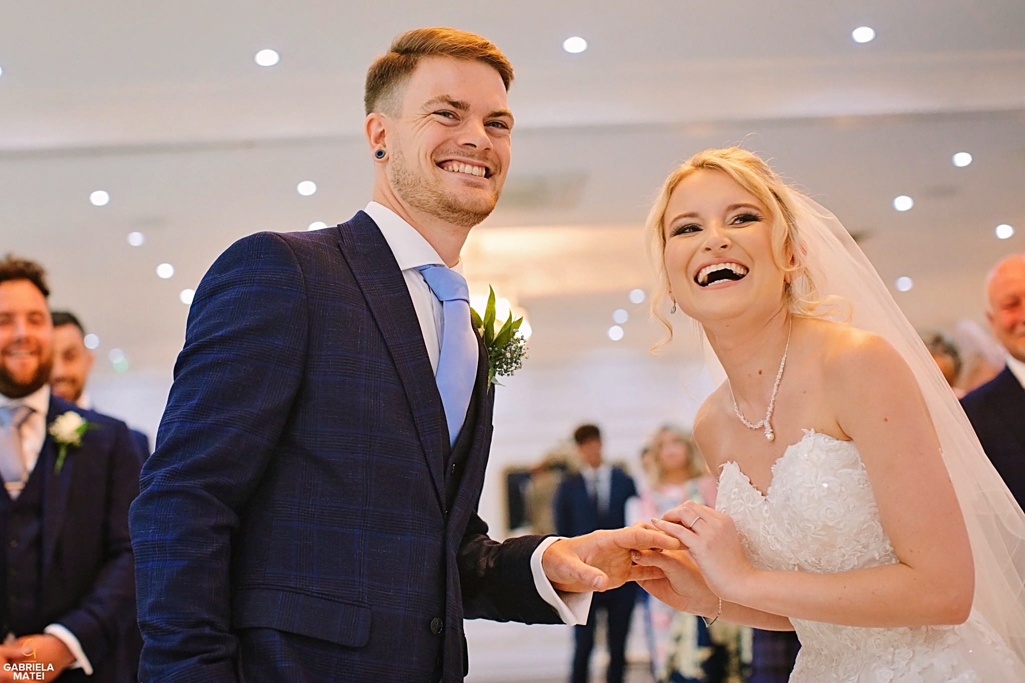 Bride and groom laughing during ring exchange vows