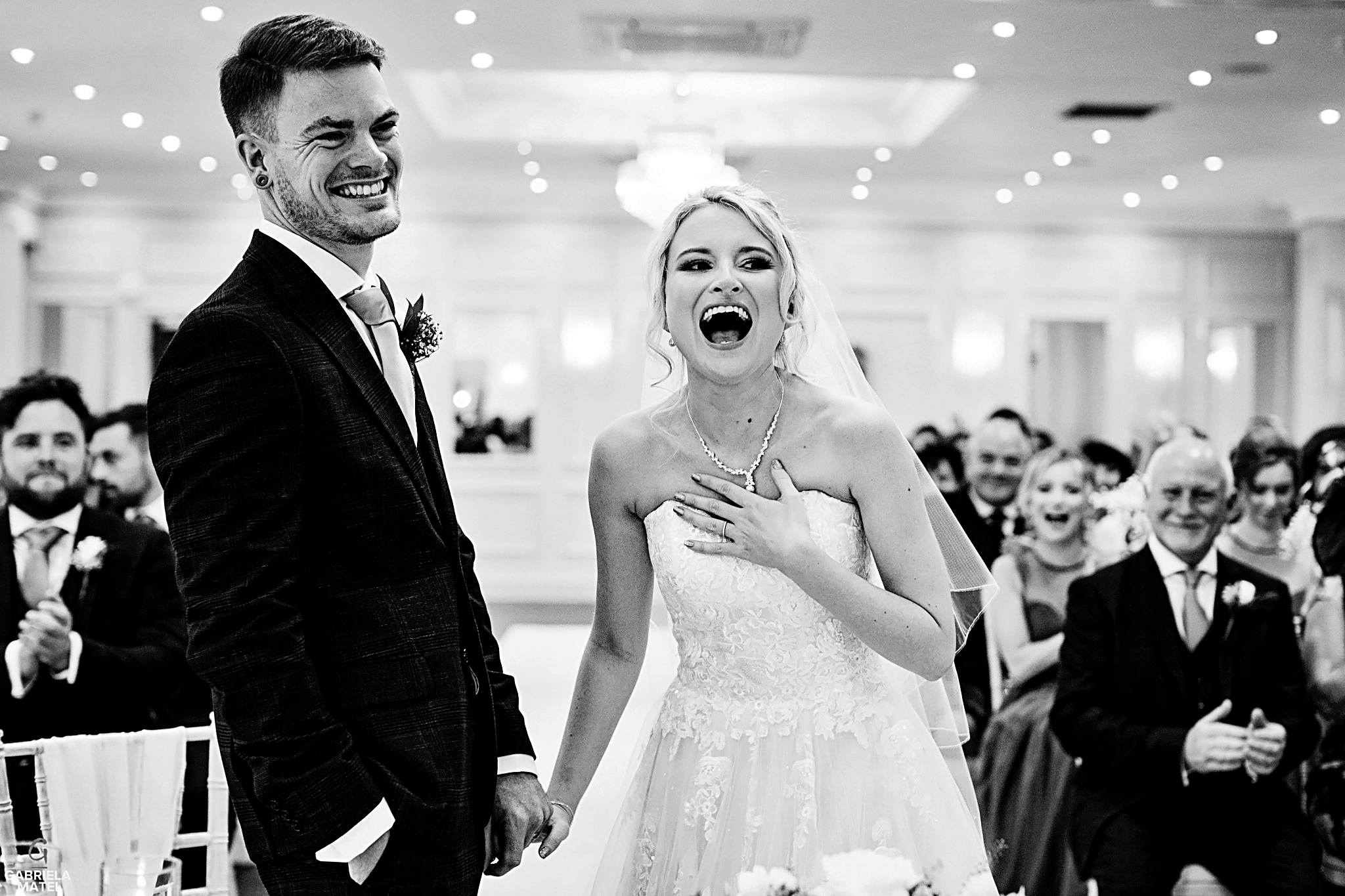 Bride and groom crack up laughing during wedding reception