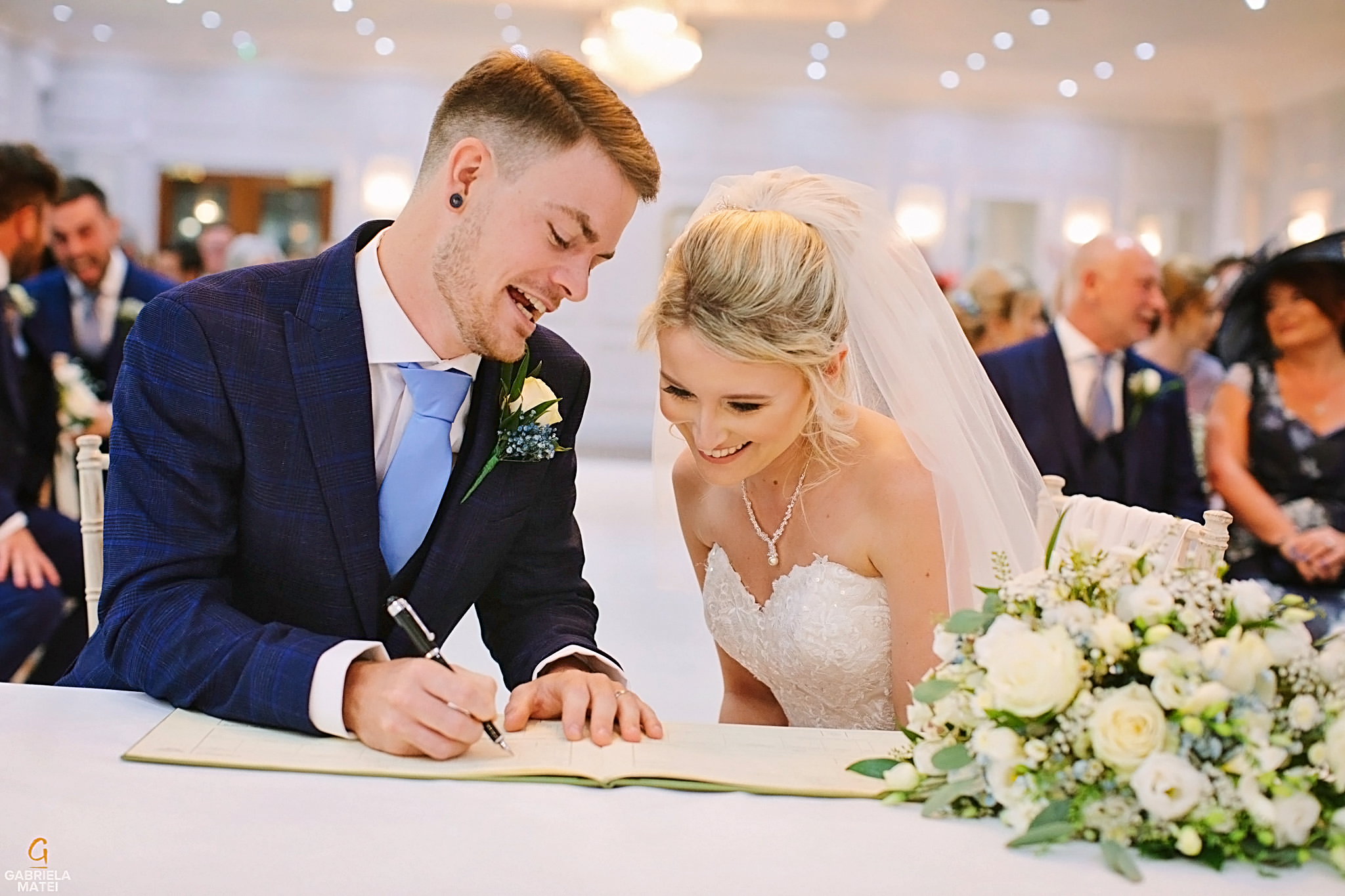 Bride and Groom signing the register during civil wedding in London venue