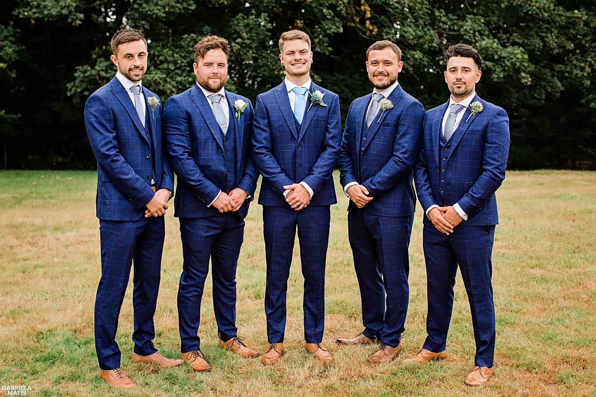Wedding group shot with groom and his groomsmen