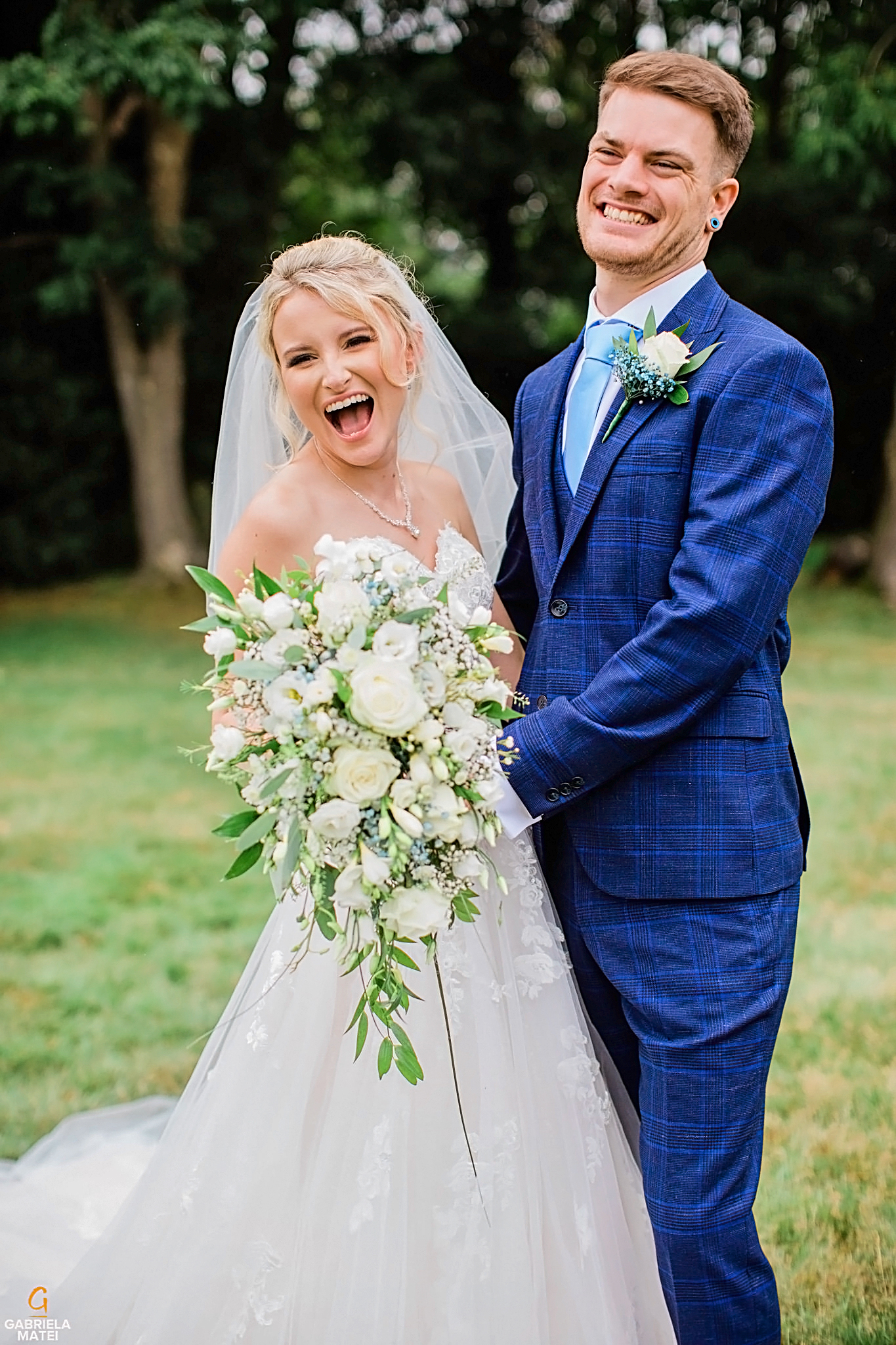 Bride and groom crack up laughing during couple shoot