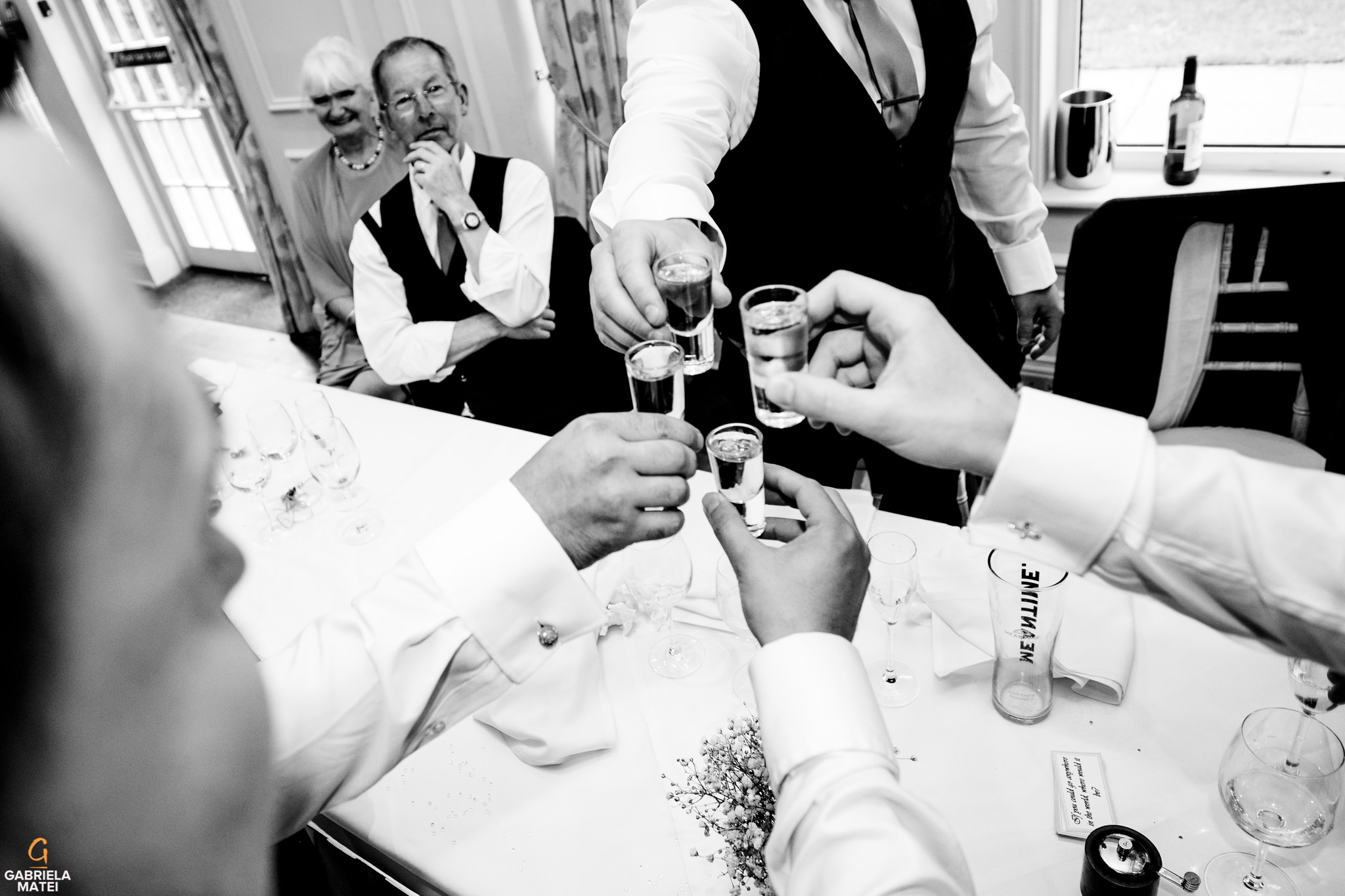 wedding guests drinking shots during wedding speeches at wedding in London