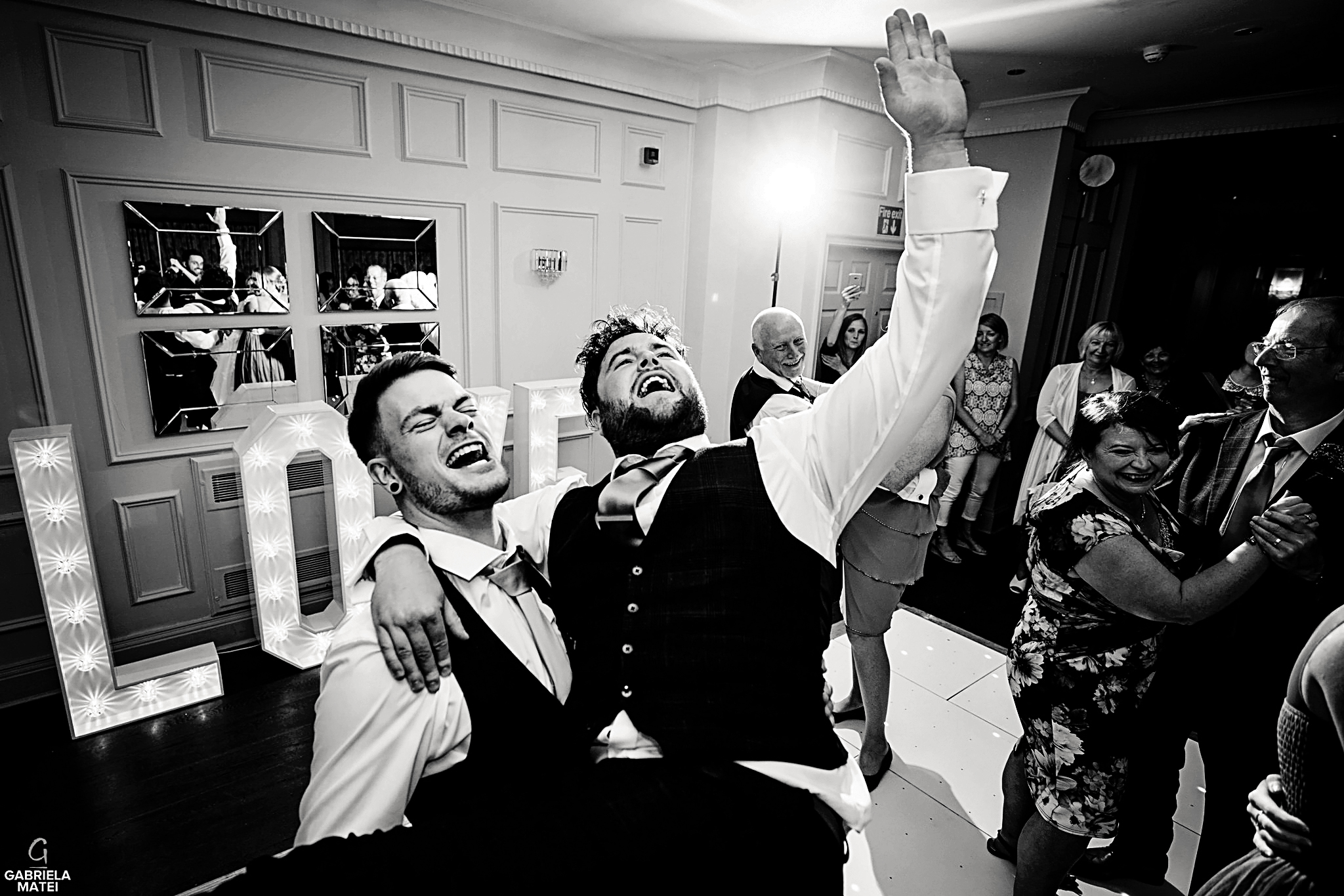 Groom picks up his best man during wedding party at wedding reception in London
