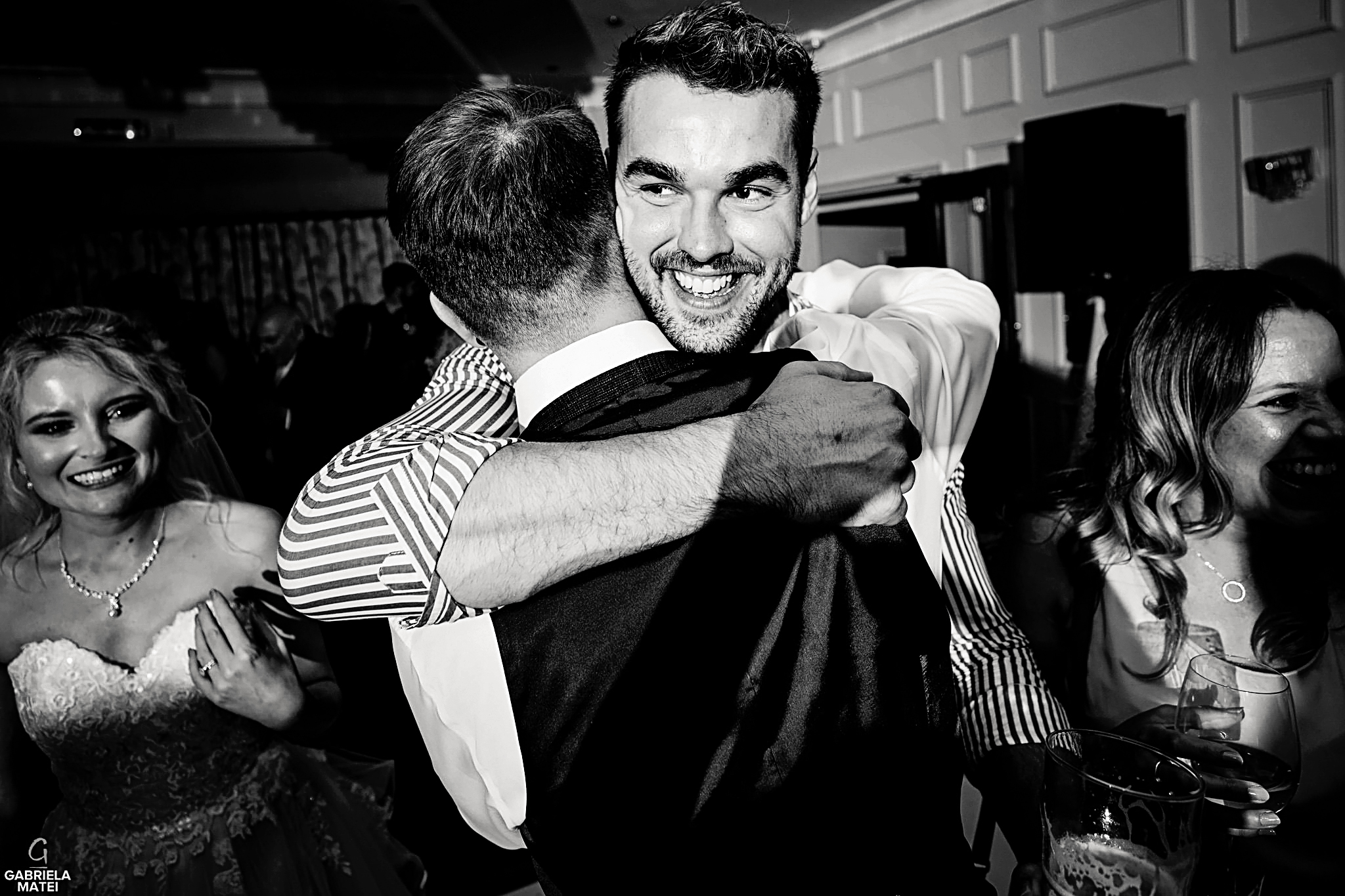 Wedding guest hugging the groom during wedding reception in London