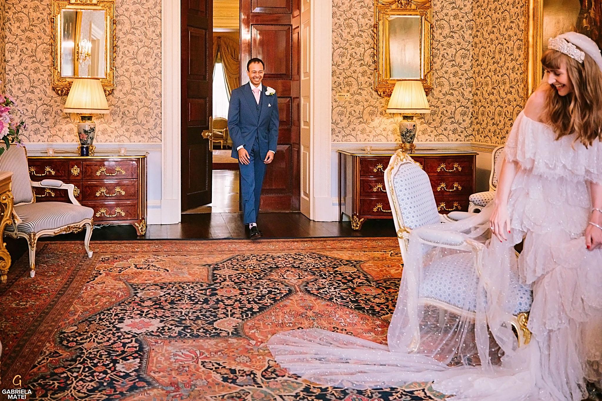 Groom walking in Queen Elisabeth Room to meet his bride at The Ritz hotel in London