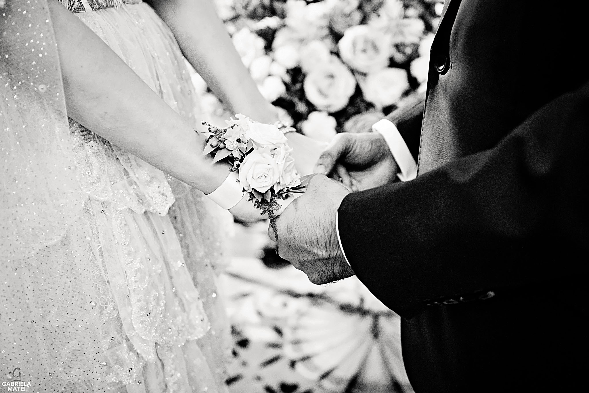 Detail shot of bride and groom holding hands during civil wedding at the Ritz hotel in London