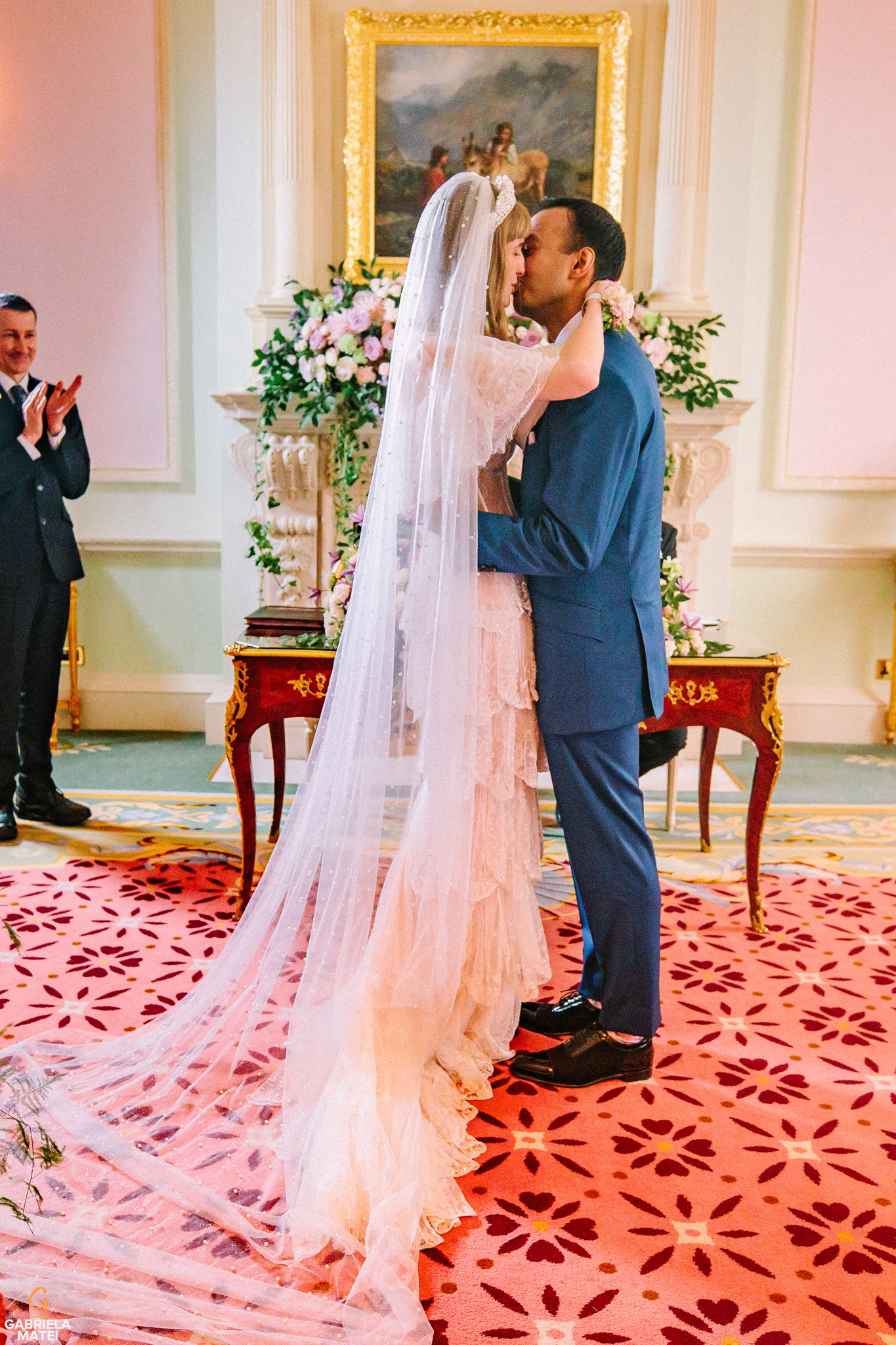 Bride and groom kissing during civil wedding at The Ritz hotel in London