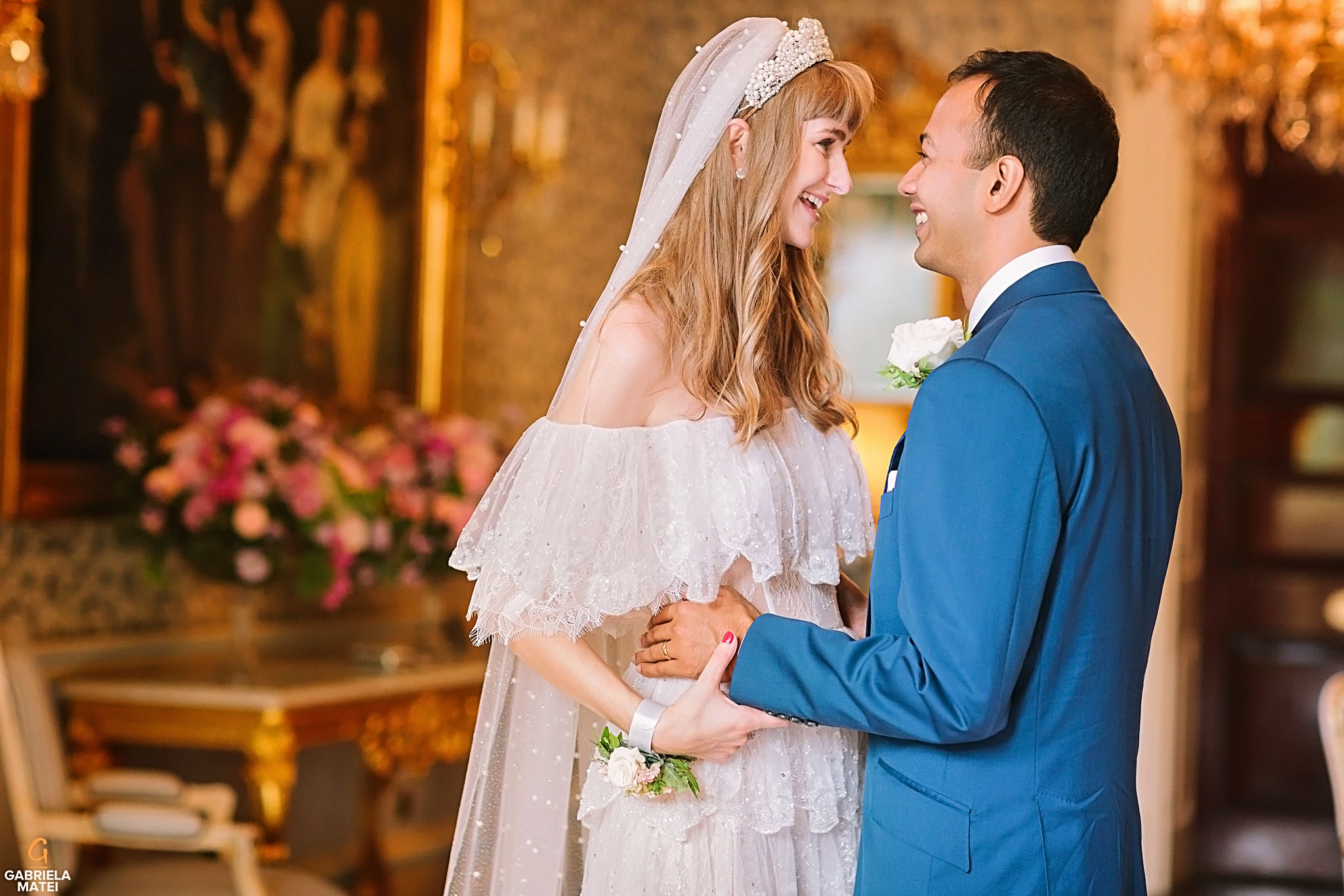 Bride and groom holding hands laughing during couple shoot at The Ritz hotel in London