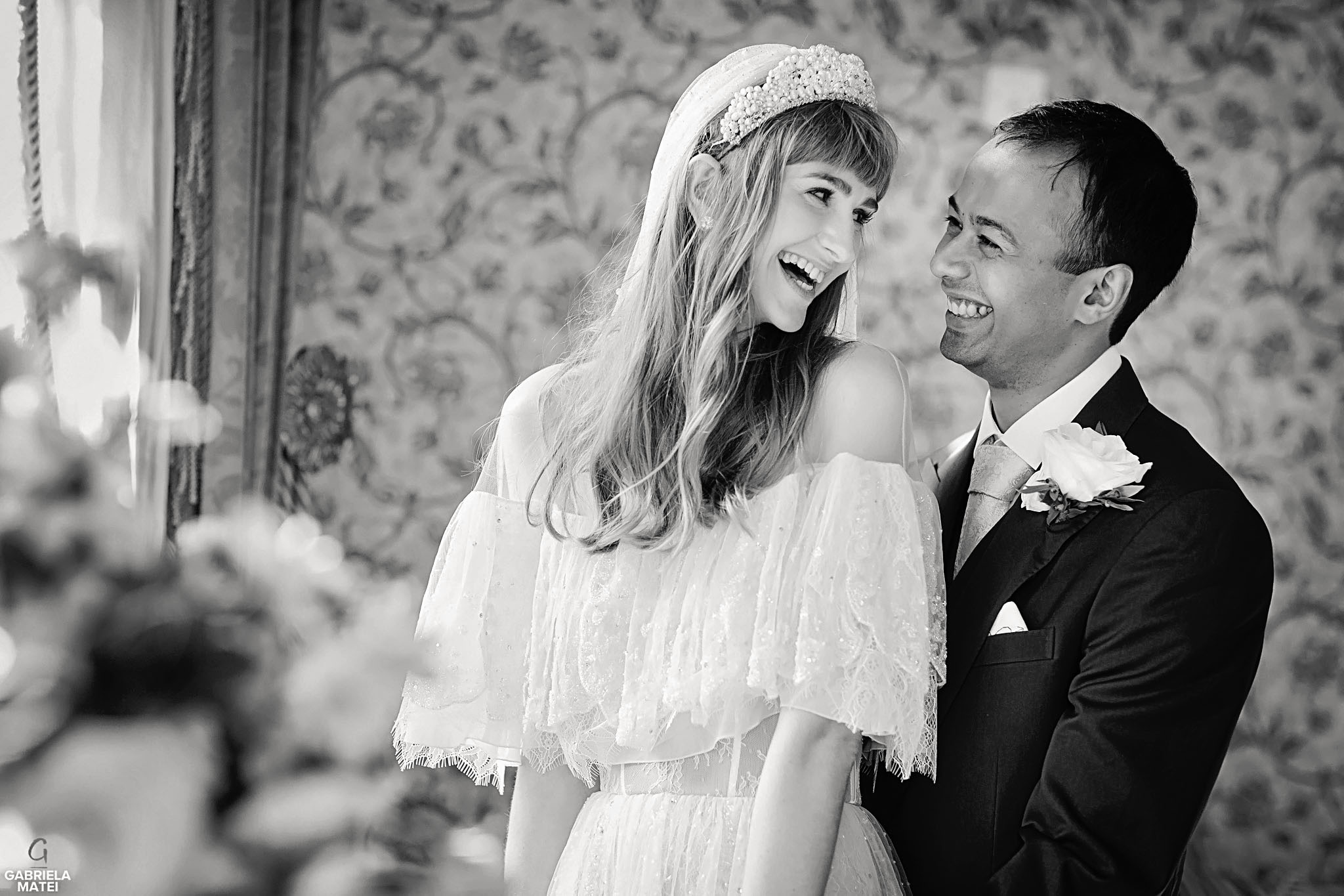 Bride and groom laughing, looking towards each other during wedding couple shoot at The Ritz in London