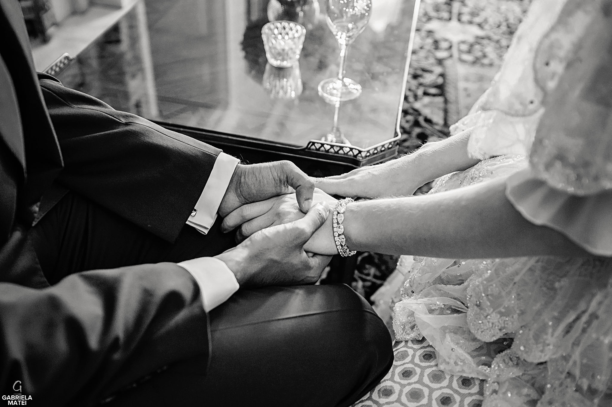 Close up of bride and groom' holding hands in Queen Elisabeth Room at The Ritz hotel in London