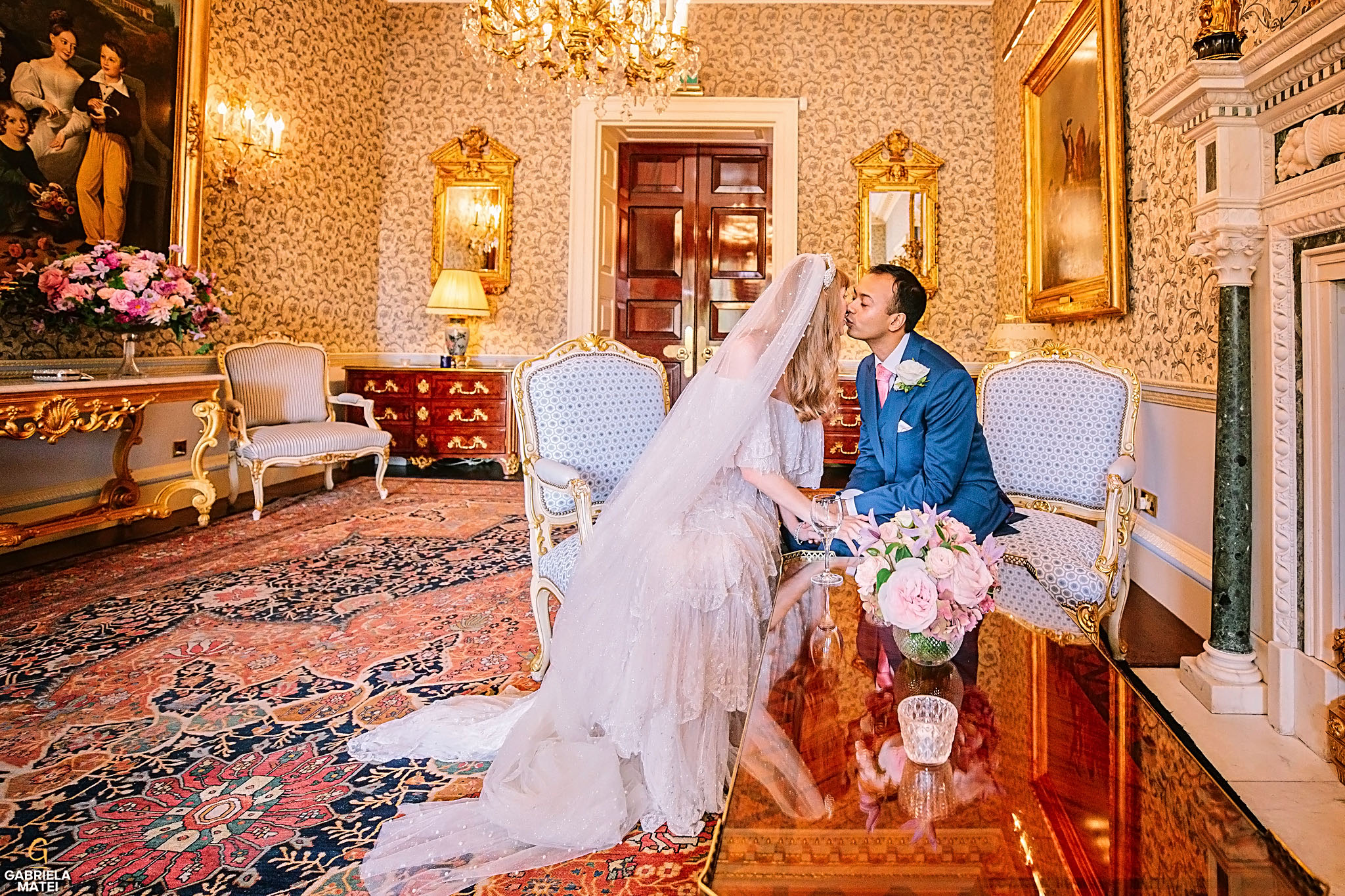 Bride and groom kissing at The Ritz in London