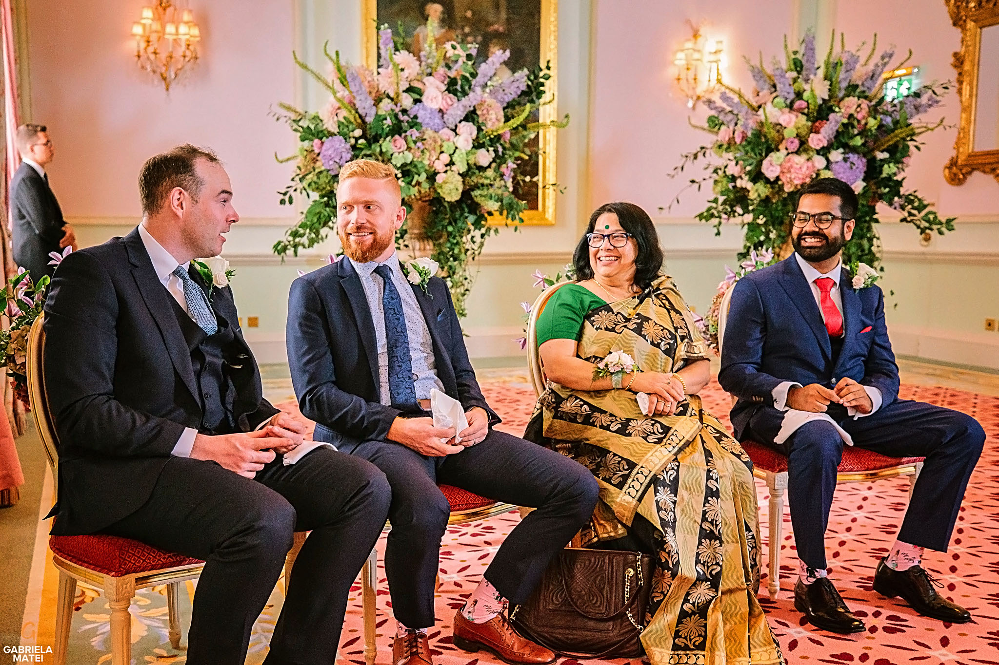 Wedding guests smiling during civil wedding in the Music Room at The Ritz in London
