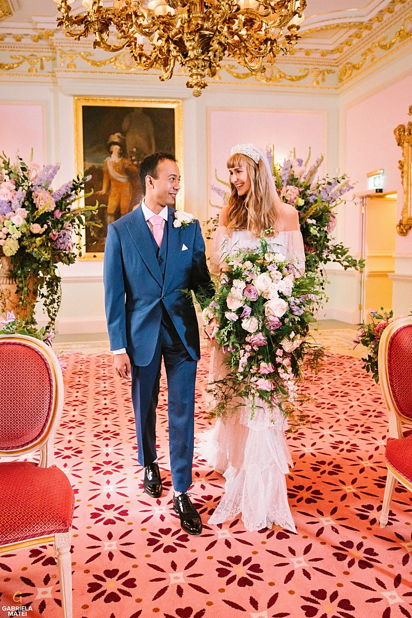 Bride and groom looking towards each other during civil wedding at The Ritz London