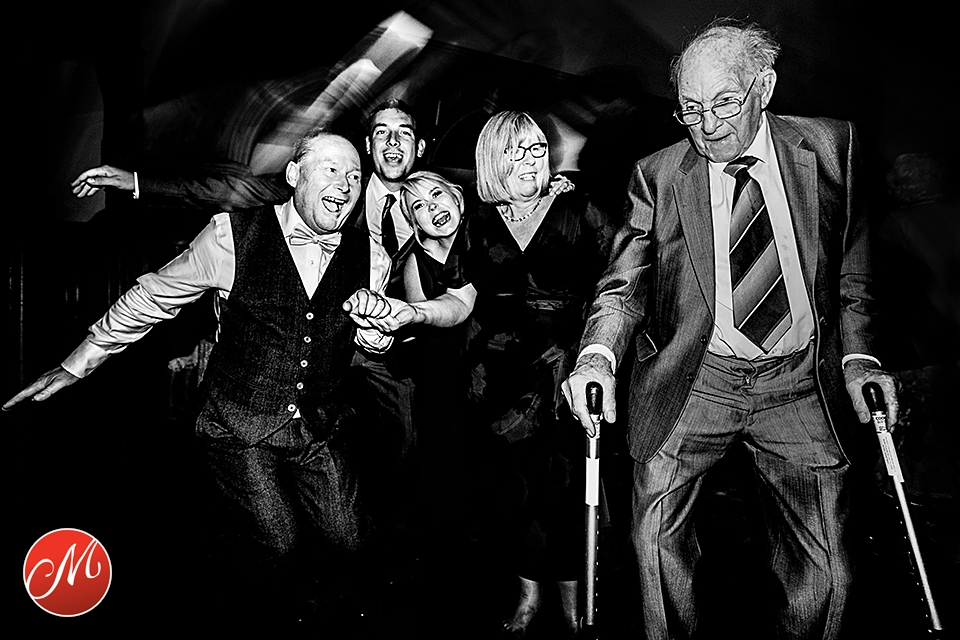 Grandfather of the groom puts up a show when he starts dancing using the help of his walking sticks at wedding reception in West Sussex