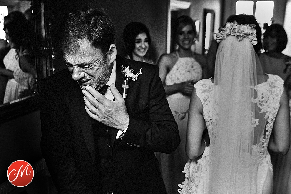 Father of the bride turns his head away to hide his tears after seeing his daughter wearing her wedding dress at wedding in West Sussex