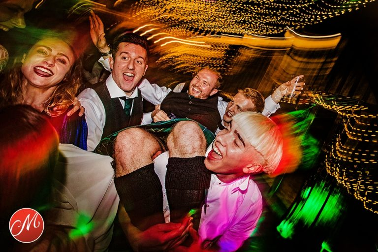 bridal party having fun during wedding party in Worthing, West Sussex