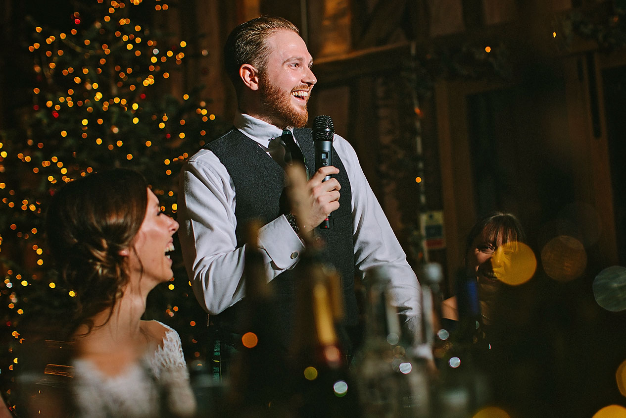 Groom laughing during speeches at  Lillibrooke Manor and Barns