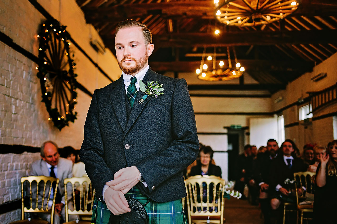 Groom wearing kilt wedding outfit waiting for his bride to walk down the aisle at Lillibrooke Manor and Barns Wedding venue