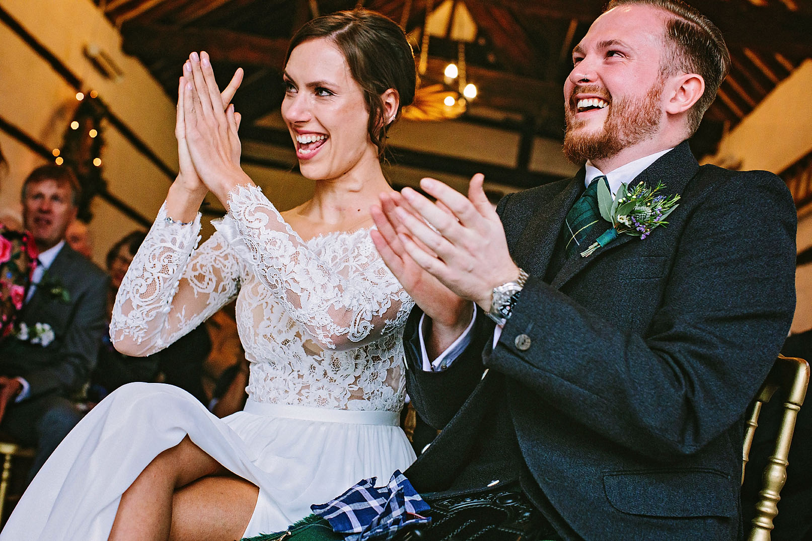 Bride and Groom clapping and laughing with tears during their alternative wedding ceremony at Lillibrooke Manor and Barns