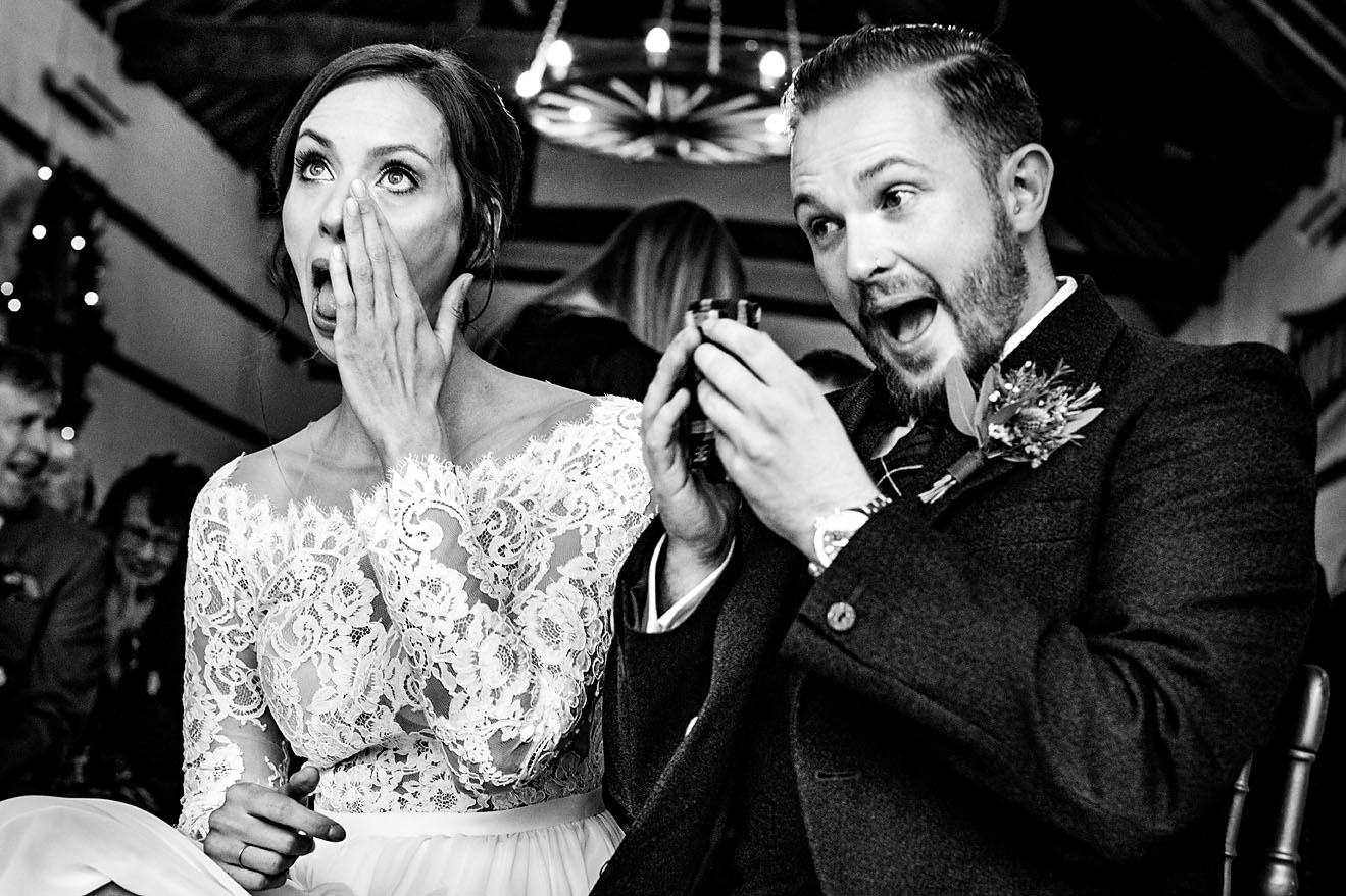 Bride and groom wiping their tears away during their alternative wedding at Lillibrooke Manor and Barns