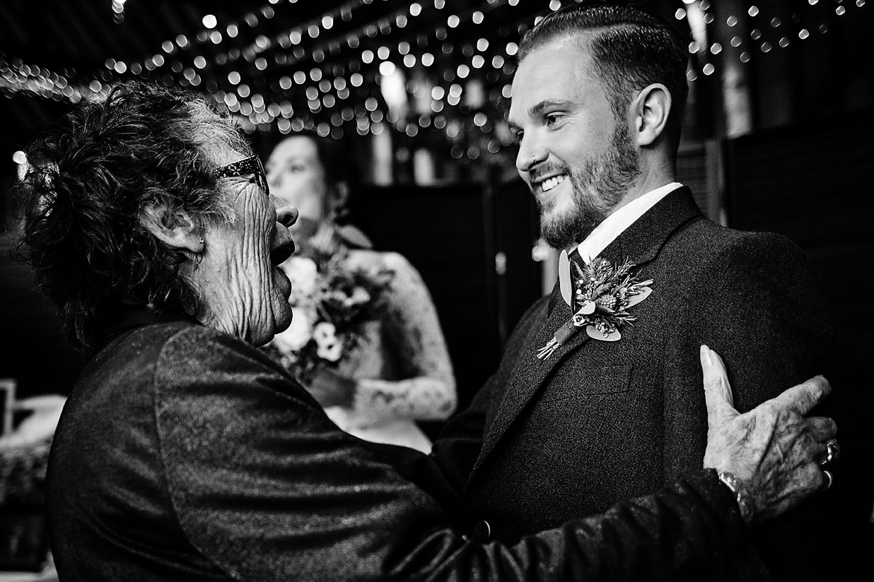 Photo of grandmother looking with excitement at at the groom during alternative wedding at Lillibrooke Manor and Barns