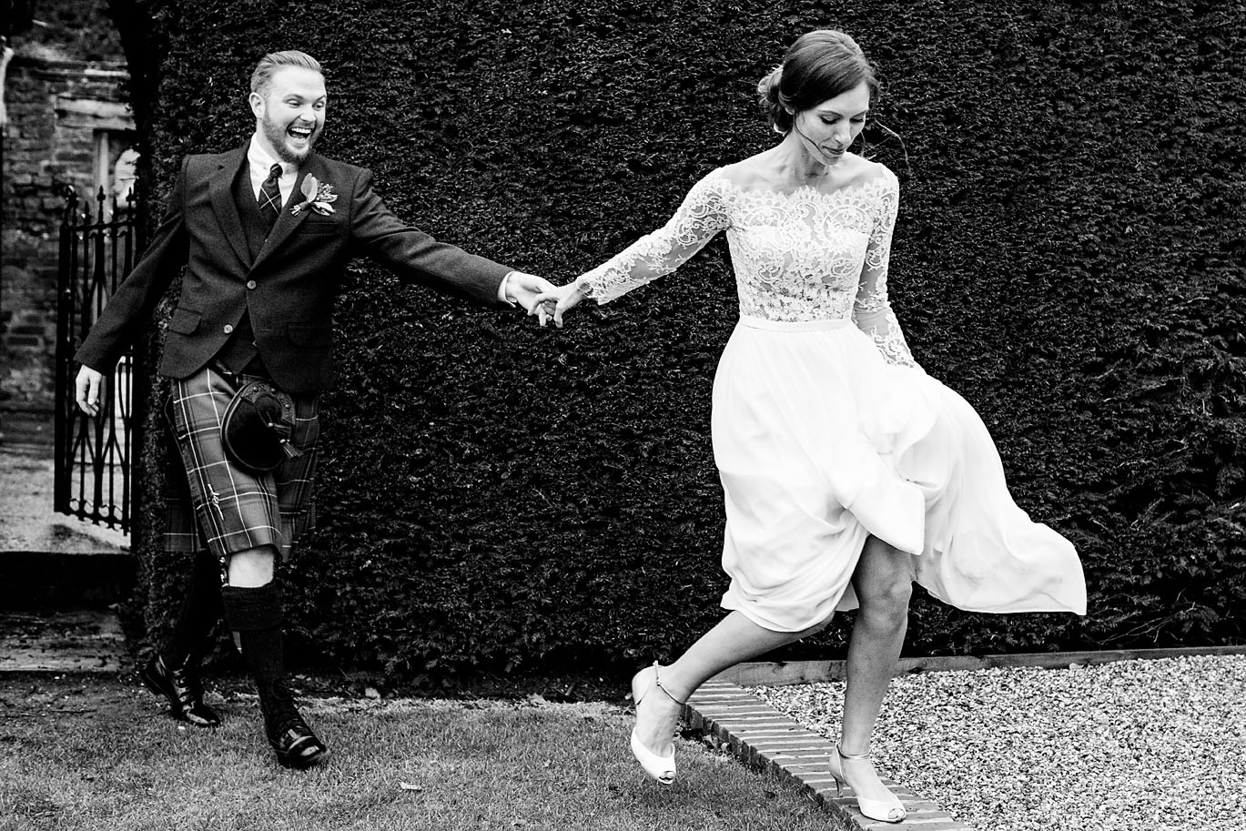 Candid image of bride and groom laughing