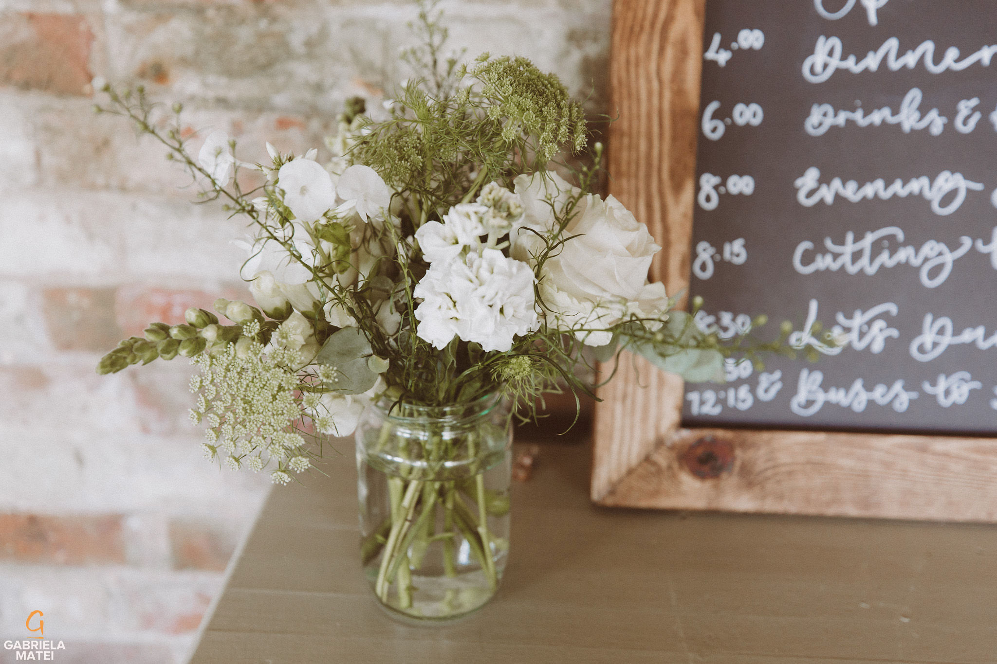 table details of flowers at South Stoke Barn wedding venue in Arundel