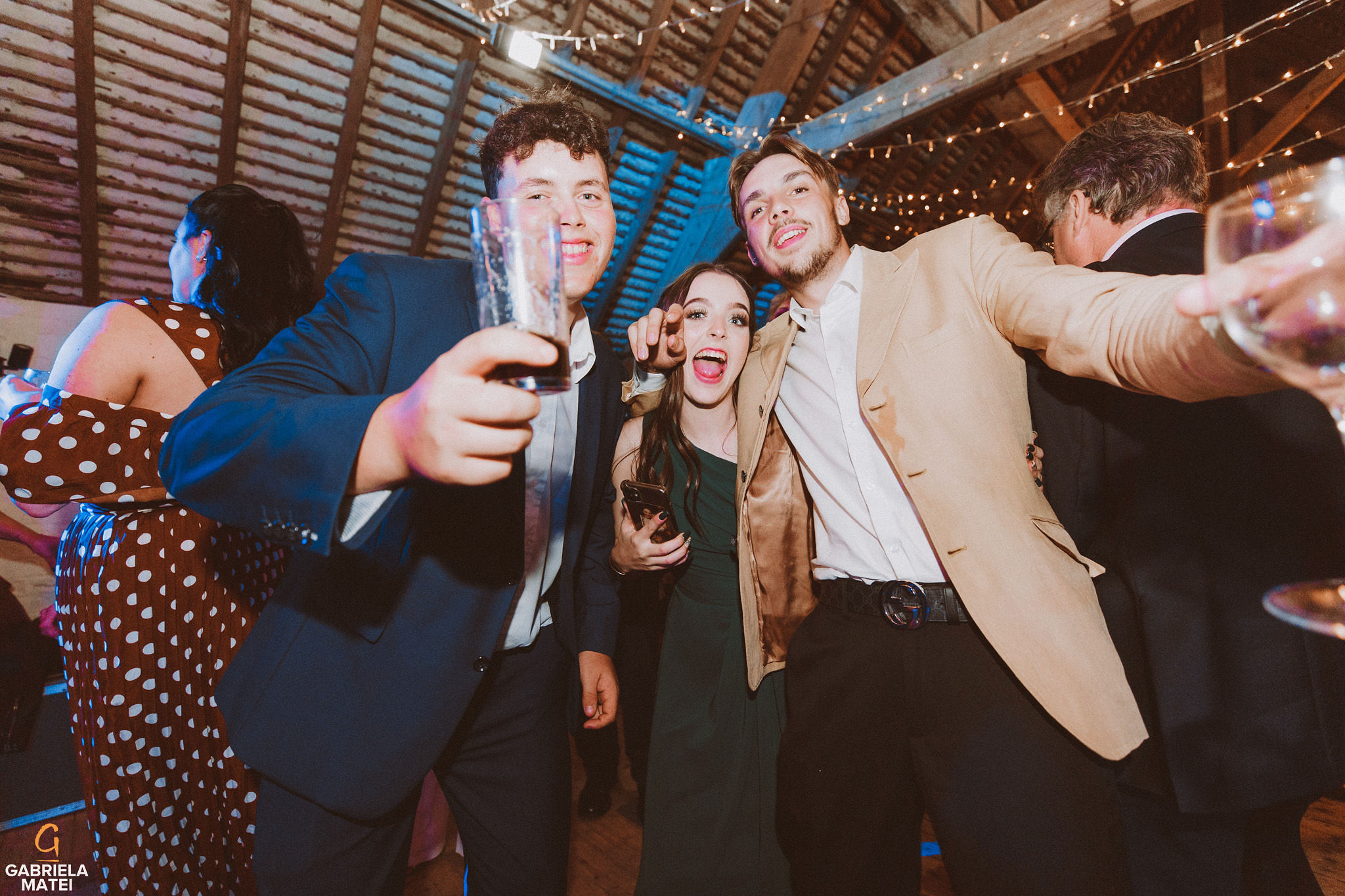 wedding guests dancing at South Stoke Barn wedding venue in Arundel by gabriela matei sussex photographer