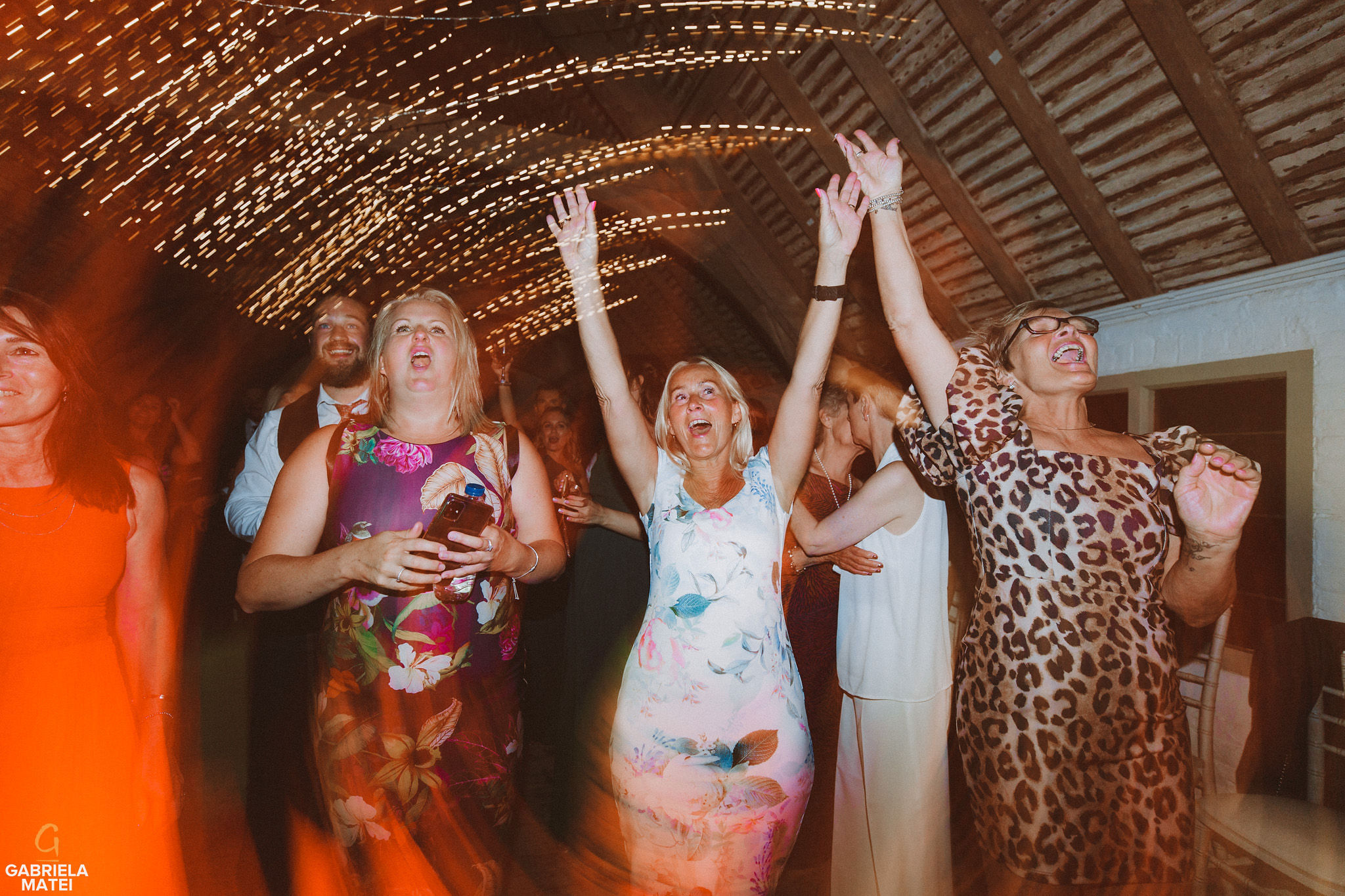 wedding guests dancing at at South Stoke Barn wedding venue in Arundel by gabriela matei sussex photographer