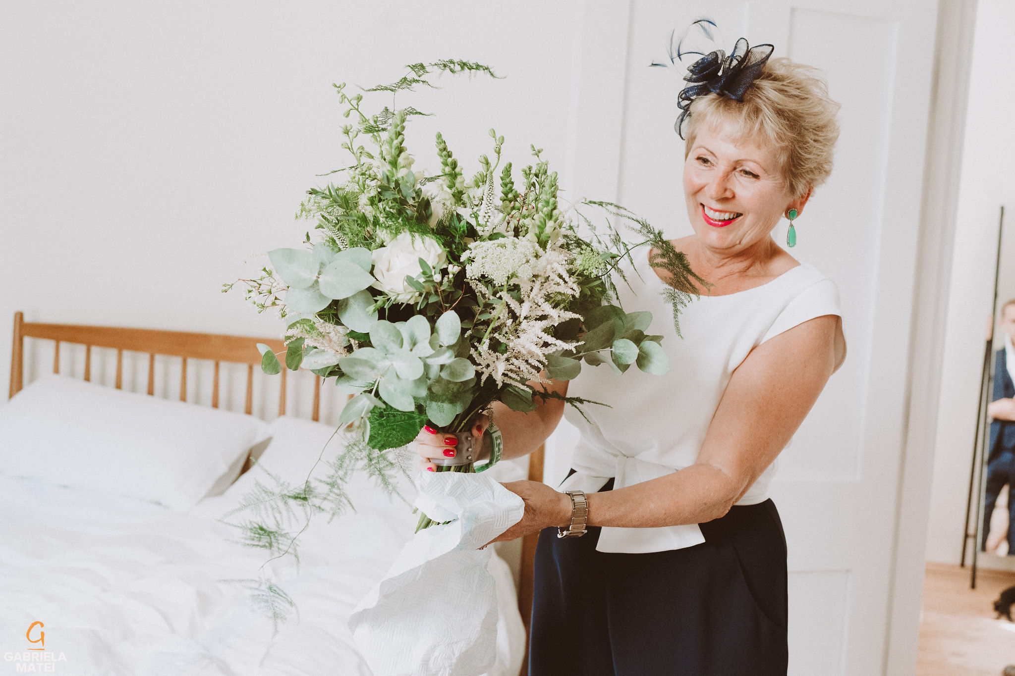 Mother of the bride presenting the wedding bouquet at South Stoke Barn wedding venue in Arundel