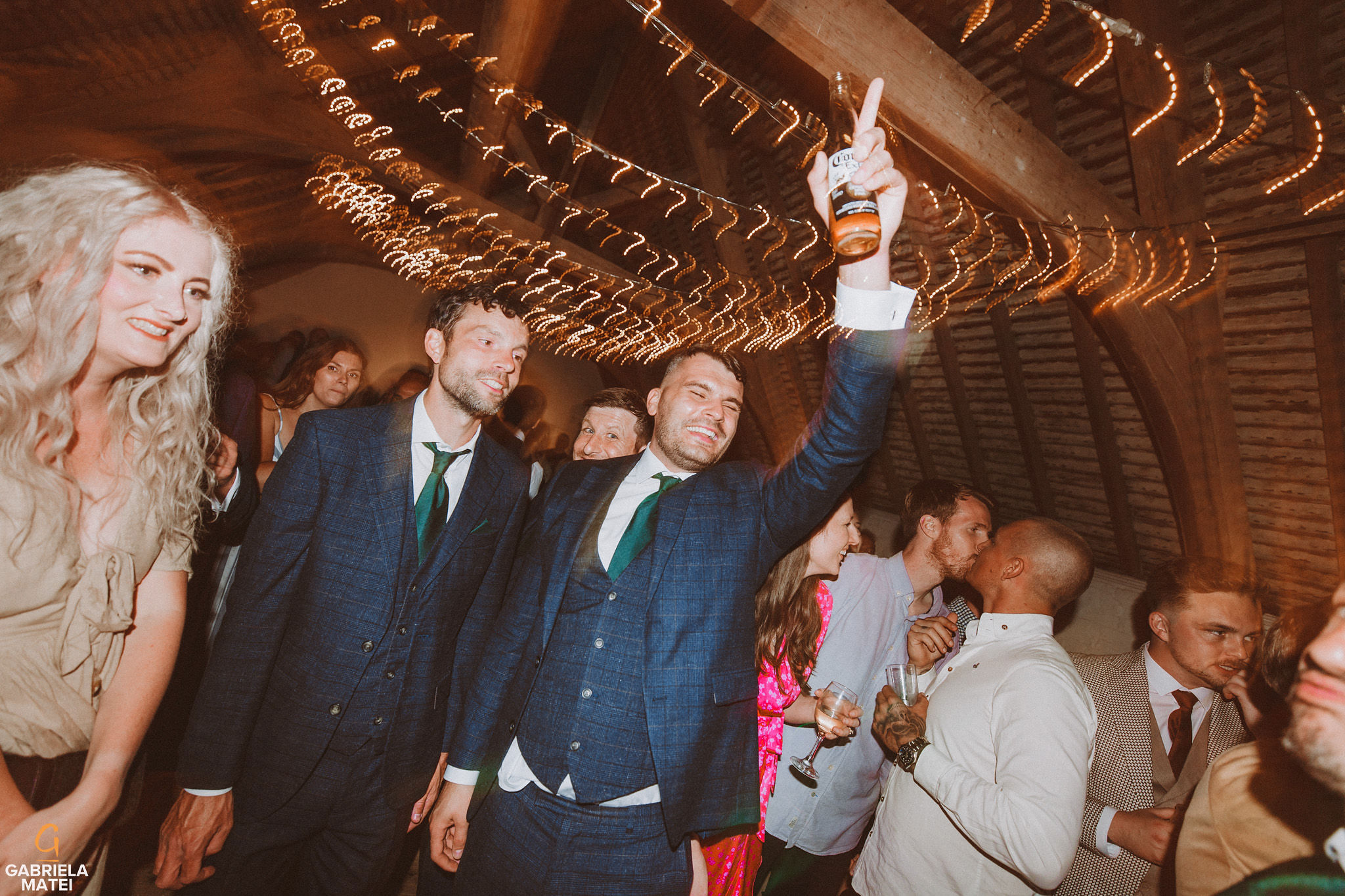 wedding guests dancing and singing at South Stoke Barn wedding venue in Arundel by gabriela matei sussex photographer