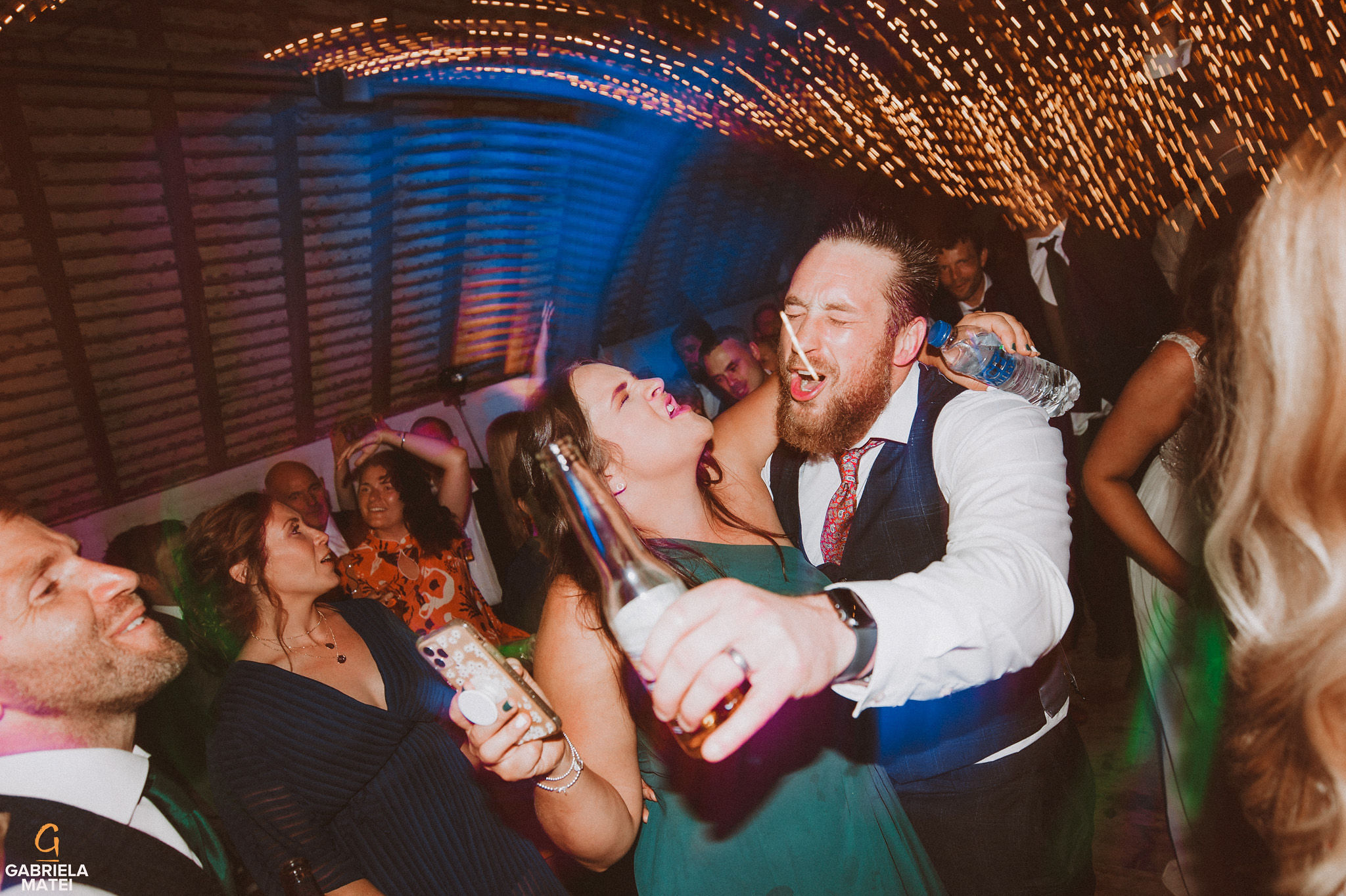 wedding couple dancing and singing at South Stoke Barn wedding venue in Arundel by gabriela matei sussex photographer