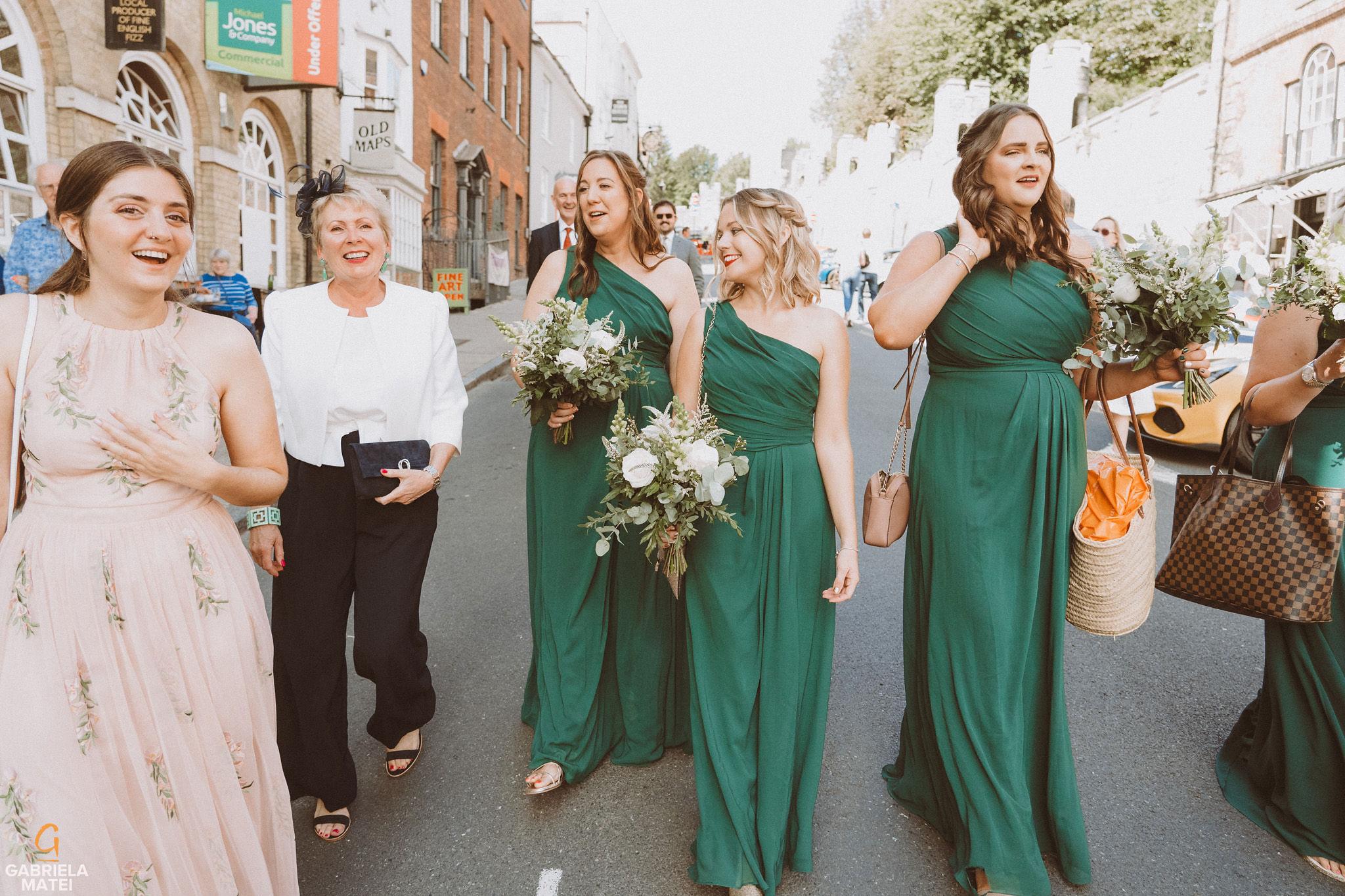 Bridesmaids walking down on High Street in Arundel during wedding at South Stoke Barn wedding venue in Arundel