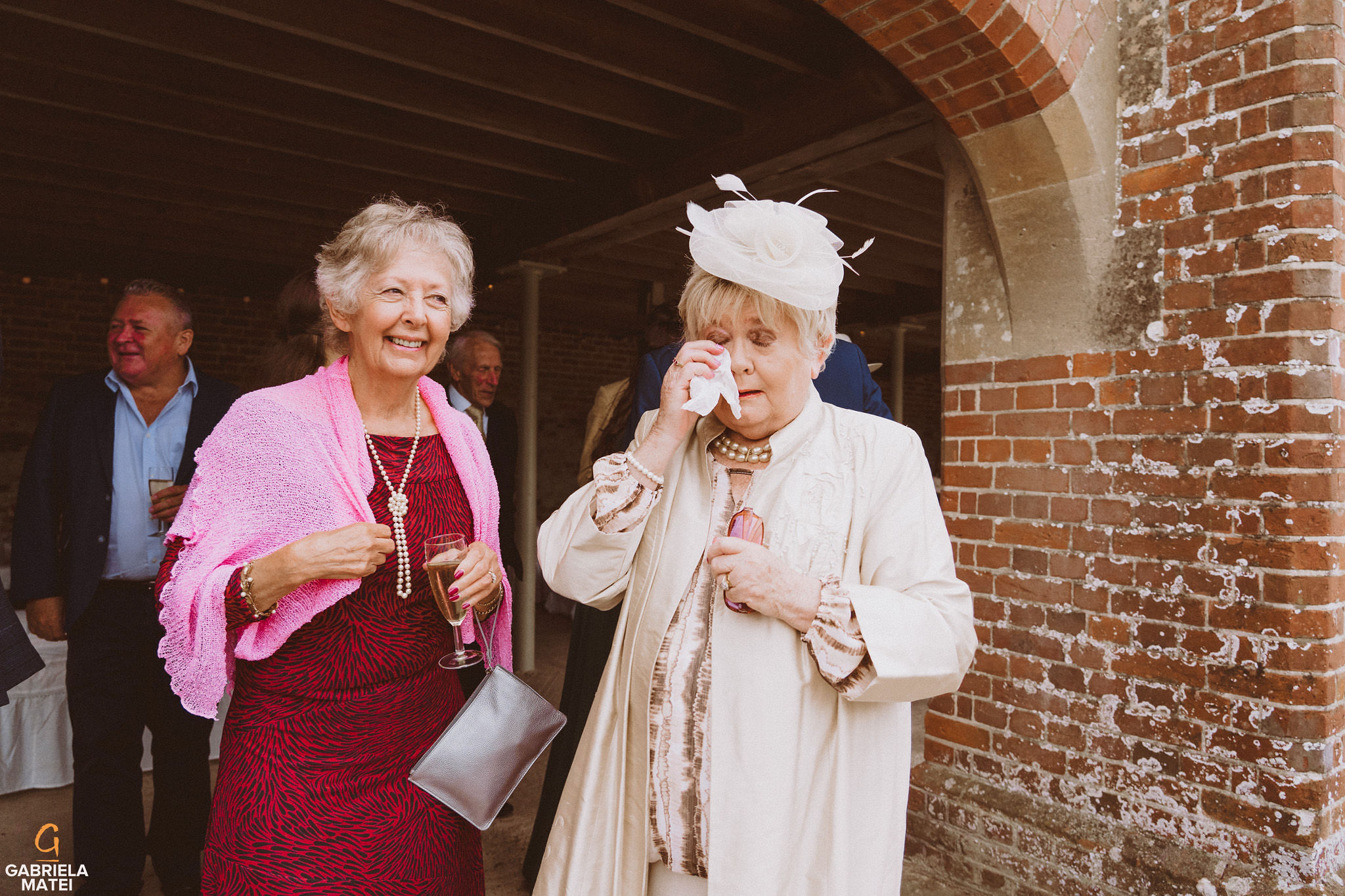Grandmother of the bride wiping her tears after she saw the bride at South Stoke Barn wedding venue in Arundel