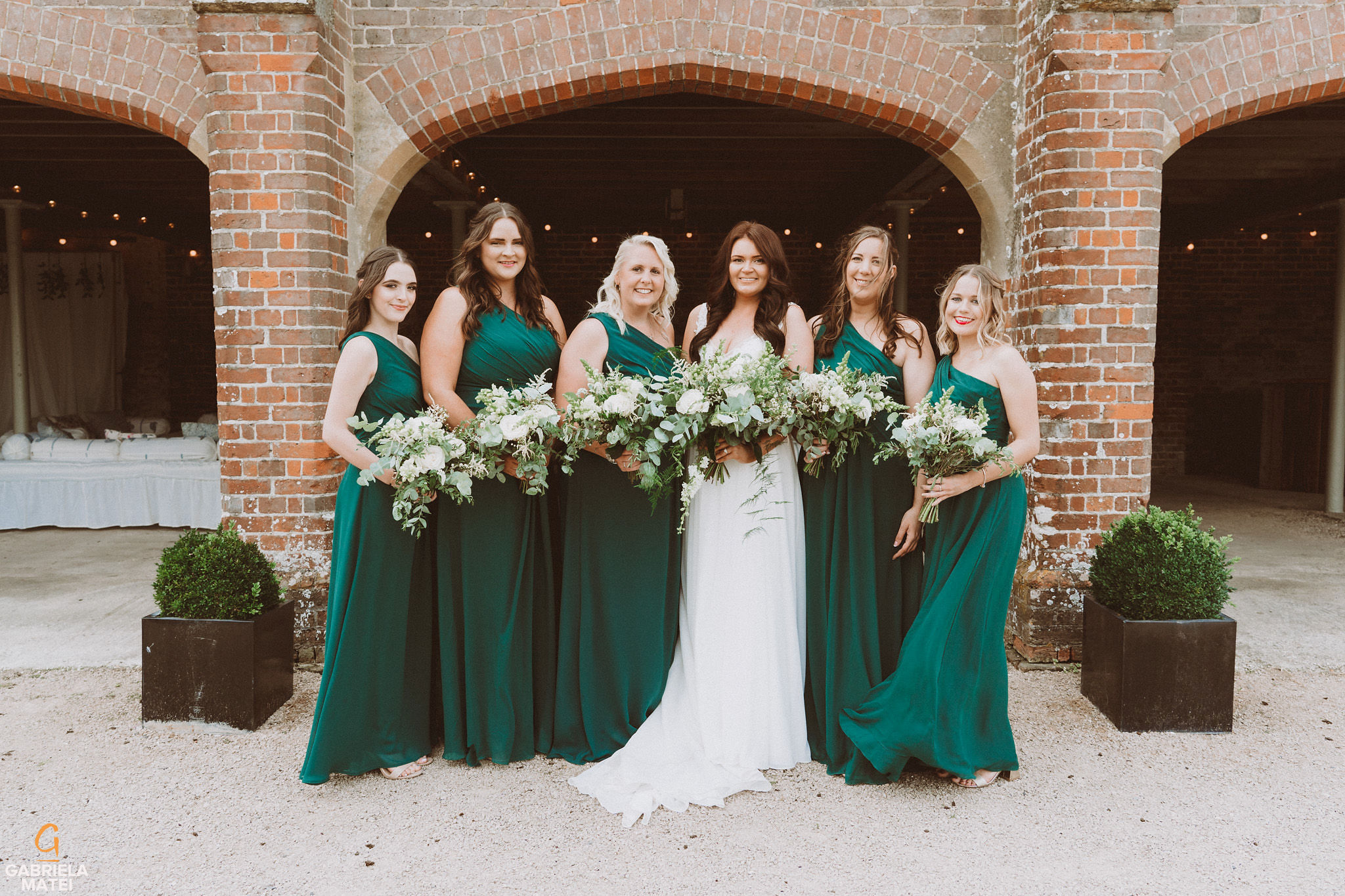 Bride and her bridesmaids at South Stoke Barn wedding venue in Arundel