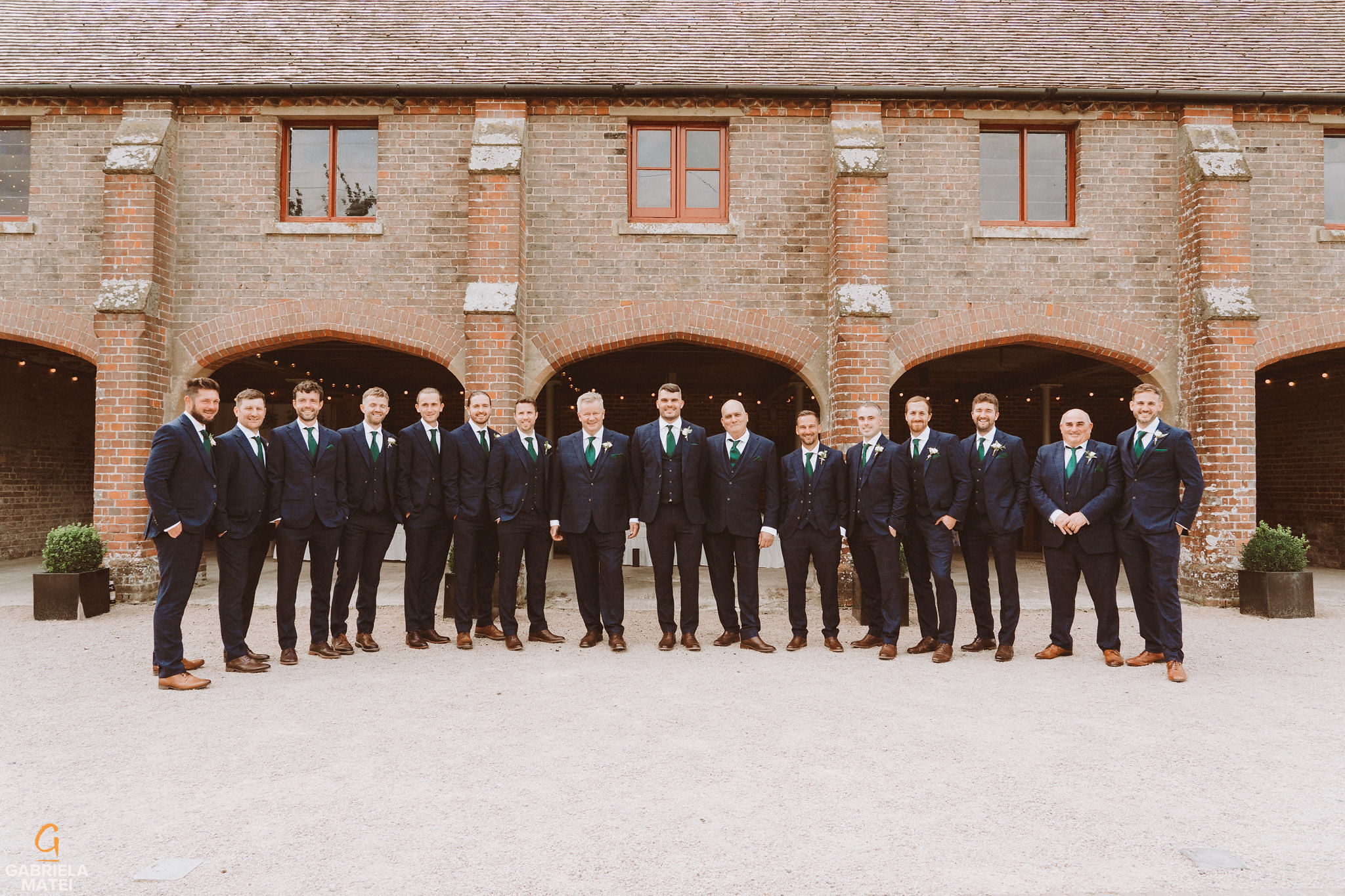 Groom and his 11 groomsmen at South Stoke Barn wedding venue in Arundel by gabriela matei sussex photographer