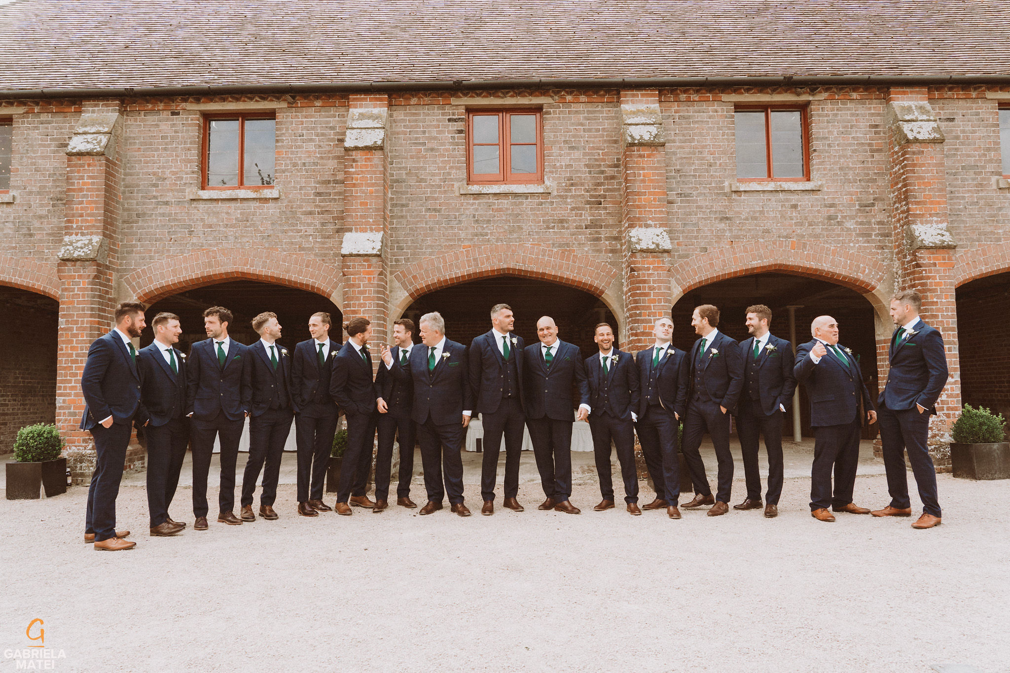 Groom and groomsmen at South Stoke Barn wedding venue in Arundel by gabriela matei sussex photographer