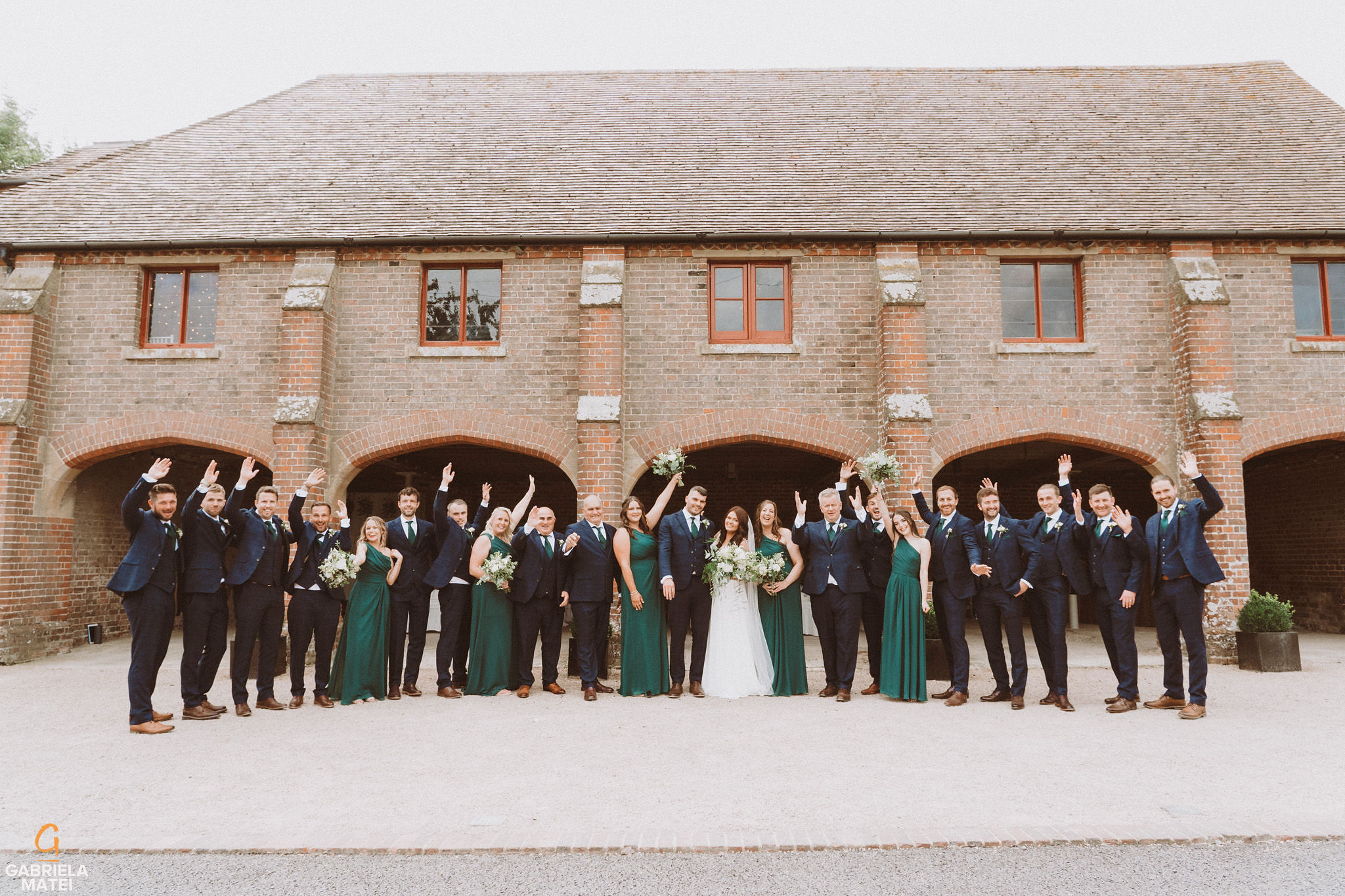 Bridal party group photo at South Stoke Barn wedding venue in Arundel by gabriela matei sussex photographer