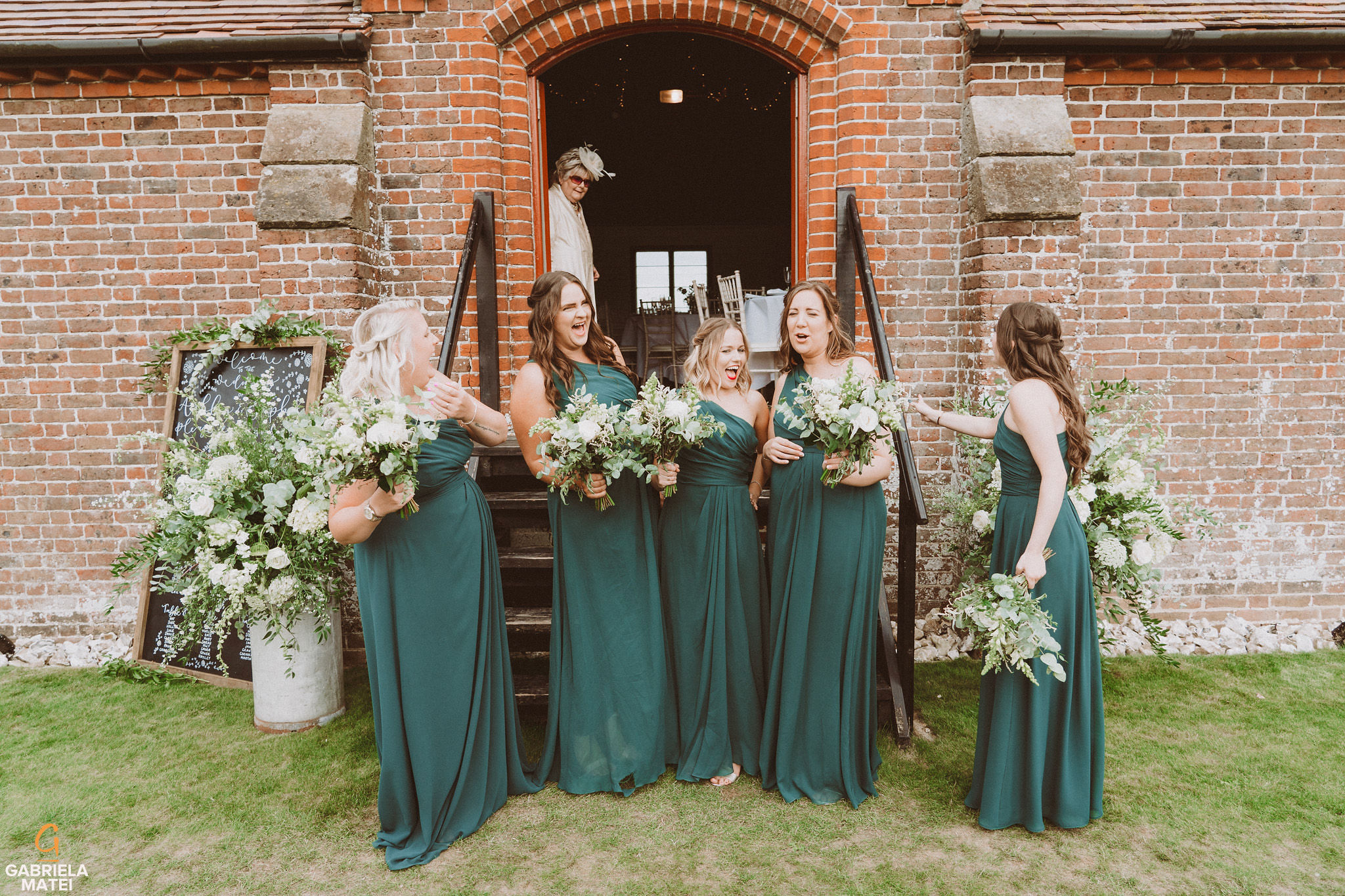 Bridesmaids having fun at South Stoke Barn wedding venue in Arundel by gabriela matei sussex photographer