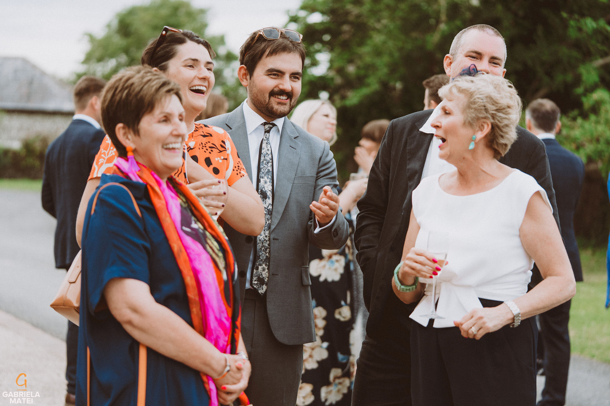 wedding guests at South Stoke Barn wedding venue in Arundel by gabriela matei sussex photographer